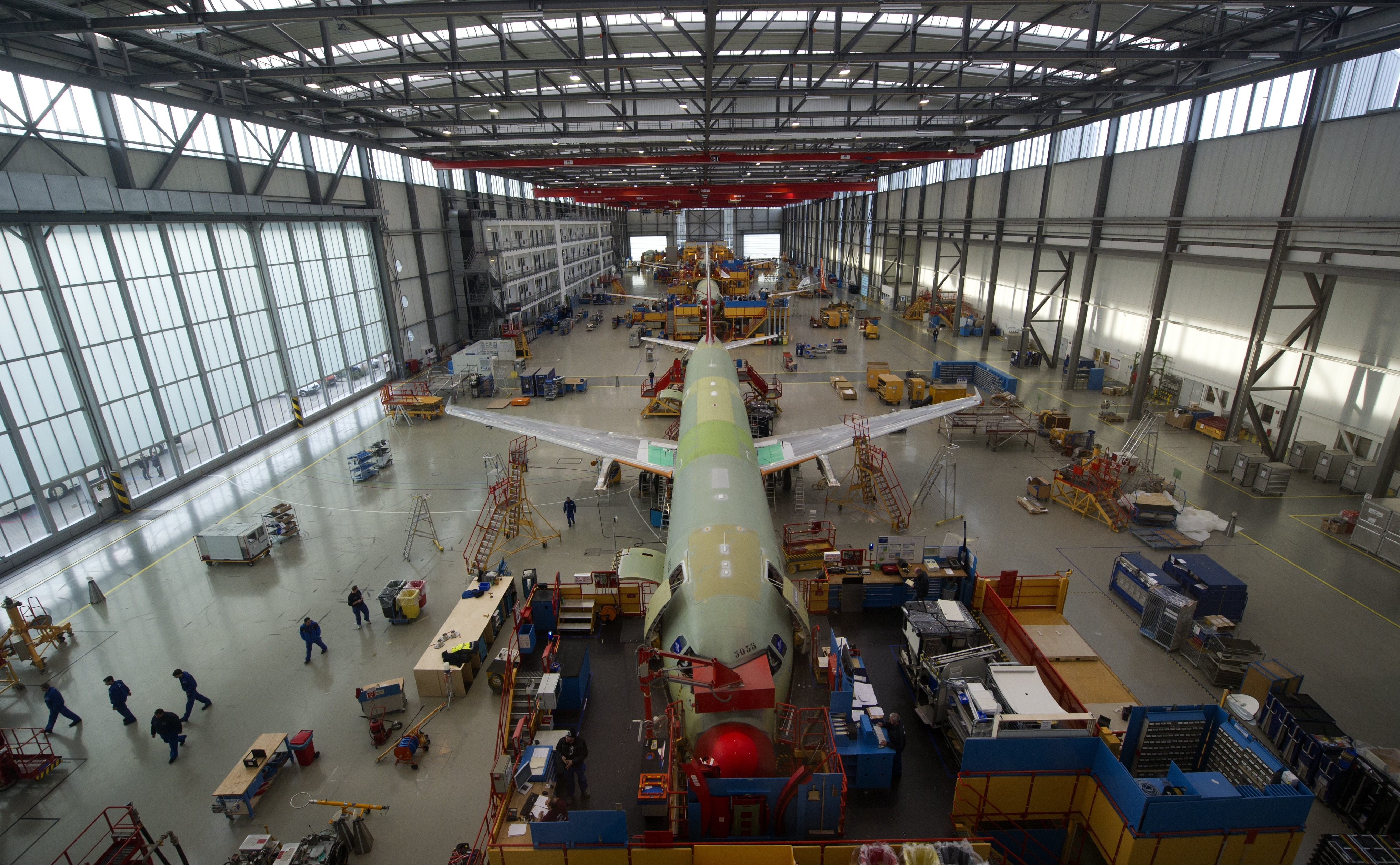 Employees of aircraft manufacturer Airbus work on an Airbus A320 plane under construction at a production hall of Airbus in Hamburg, northern Germany. A new Airbus factory has been unveiled in Alabama, setting itself up for a fierce fight with Chicago-based Boeing.