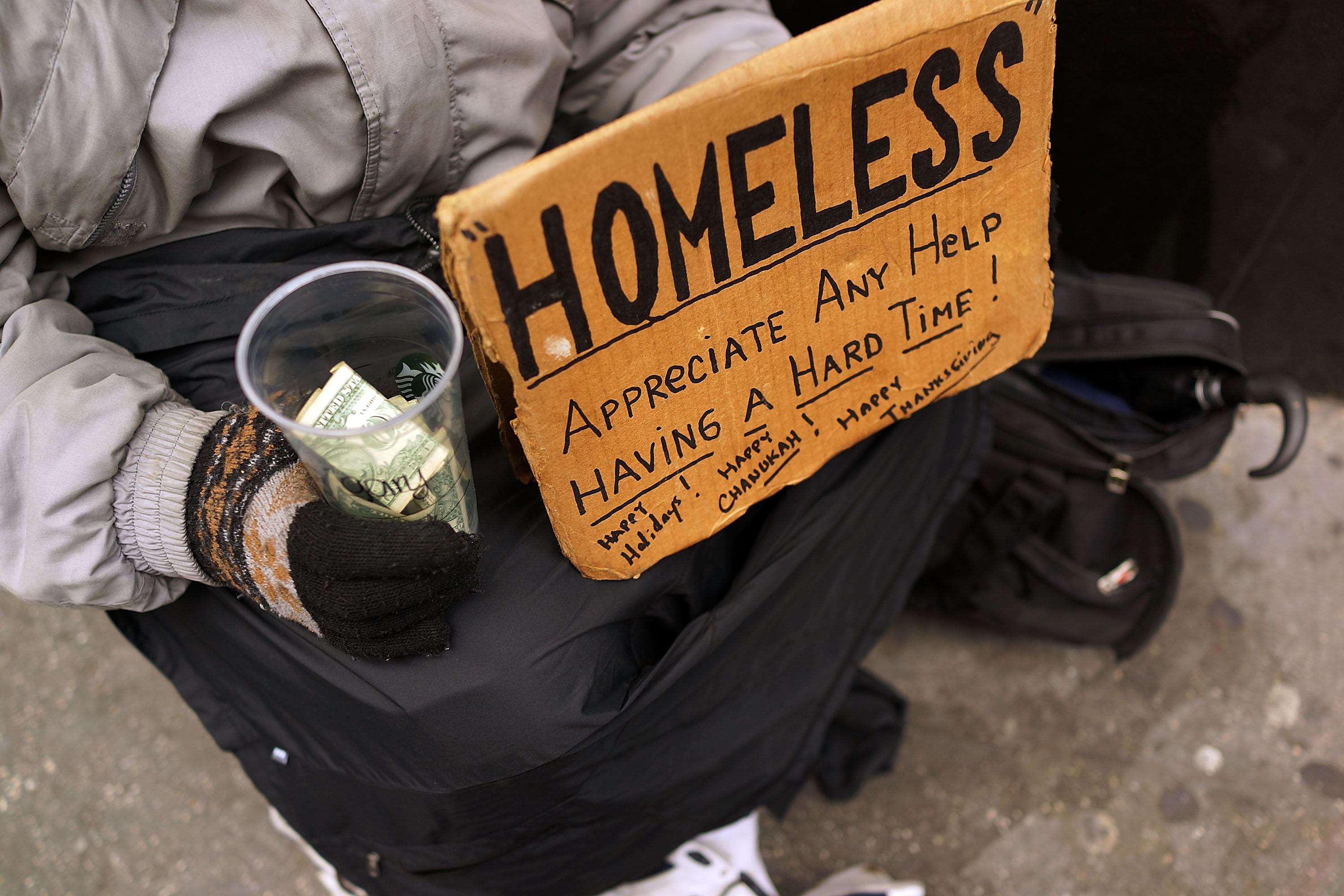 Panhandlers' Placards Show Signs Of Continued Economic Hardship