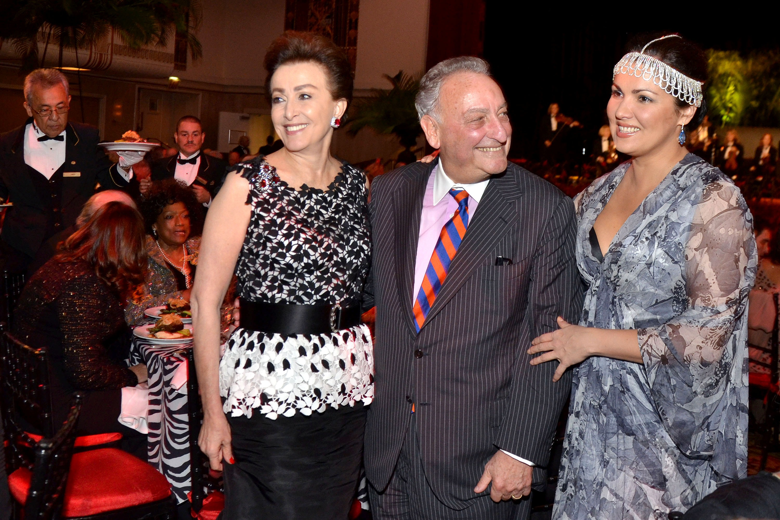 Left to right: Mercedes Bass, vice chair of the board of trustees of Carnegie Hall; Sandy Weill, chairman of Carnegie Hall; and soprano Anna Netrebko attend the Carnegie Hall dinner gala at the Waldorf Astoria in New York on Oct. 2, 2013.