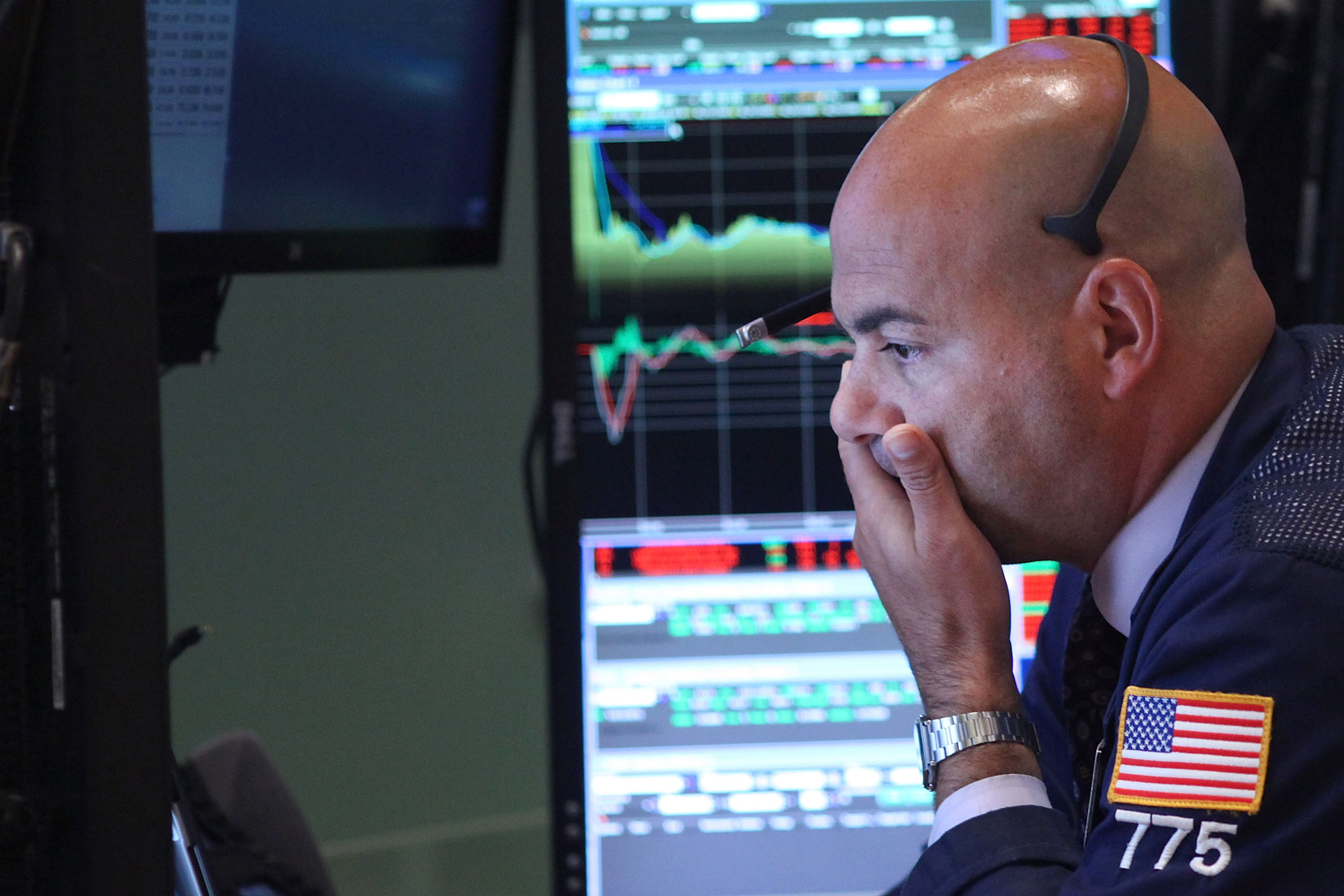 Traders react on the floor of the New York Stock Exchange on September 1, 2015 in New York City.