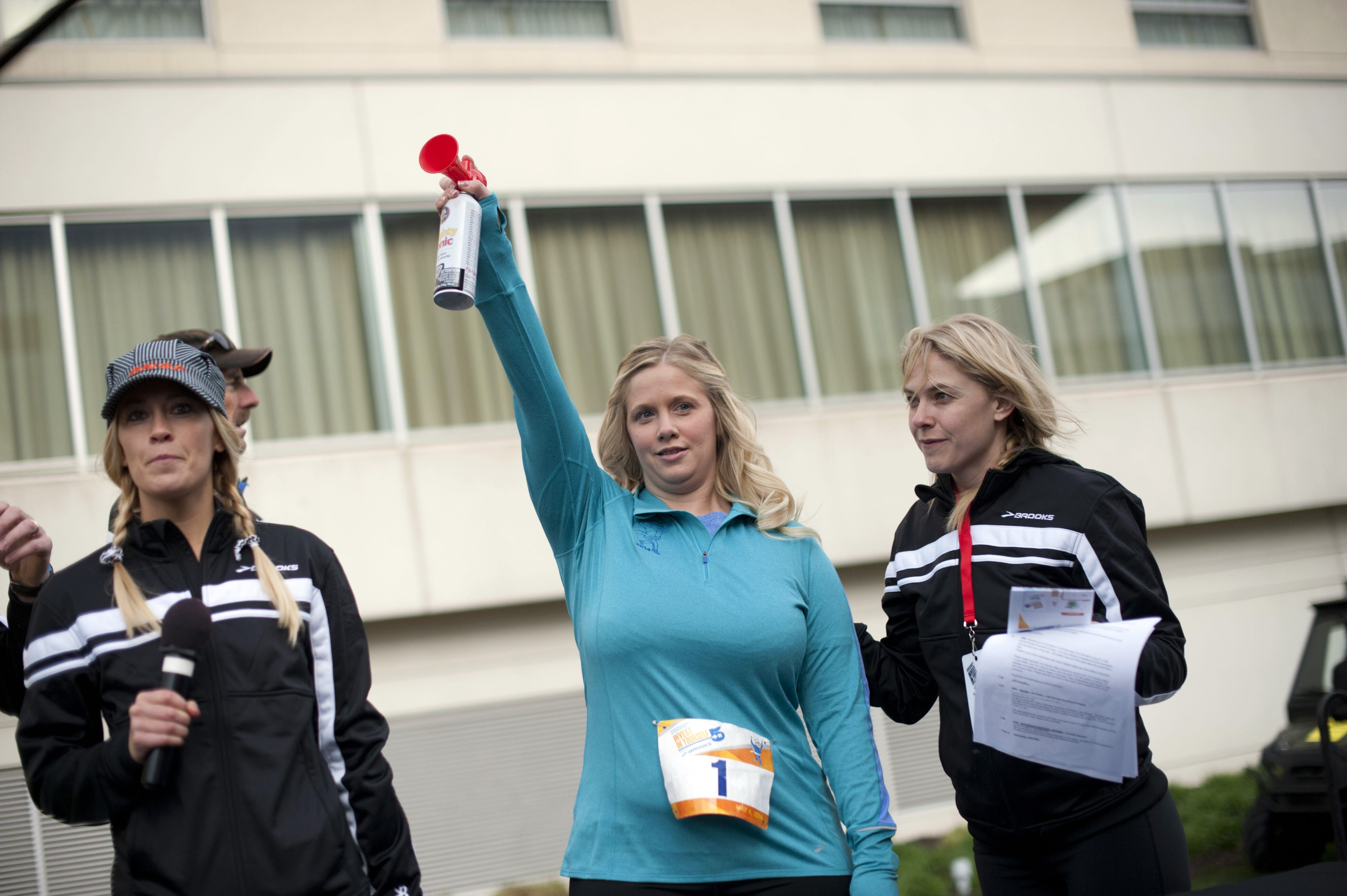 Warren Buffett protégé Tracy Britt Cool blasts an air-horn to start the 'Berkshire Hathaway Invest In Yourself 5K' race in May, 2014.