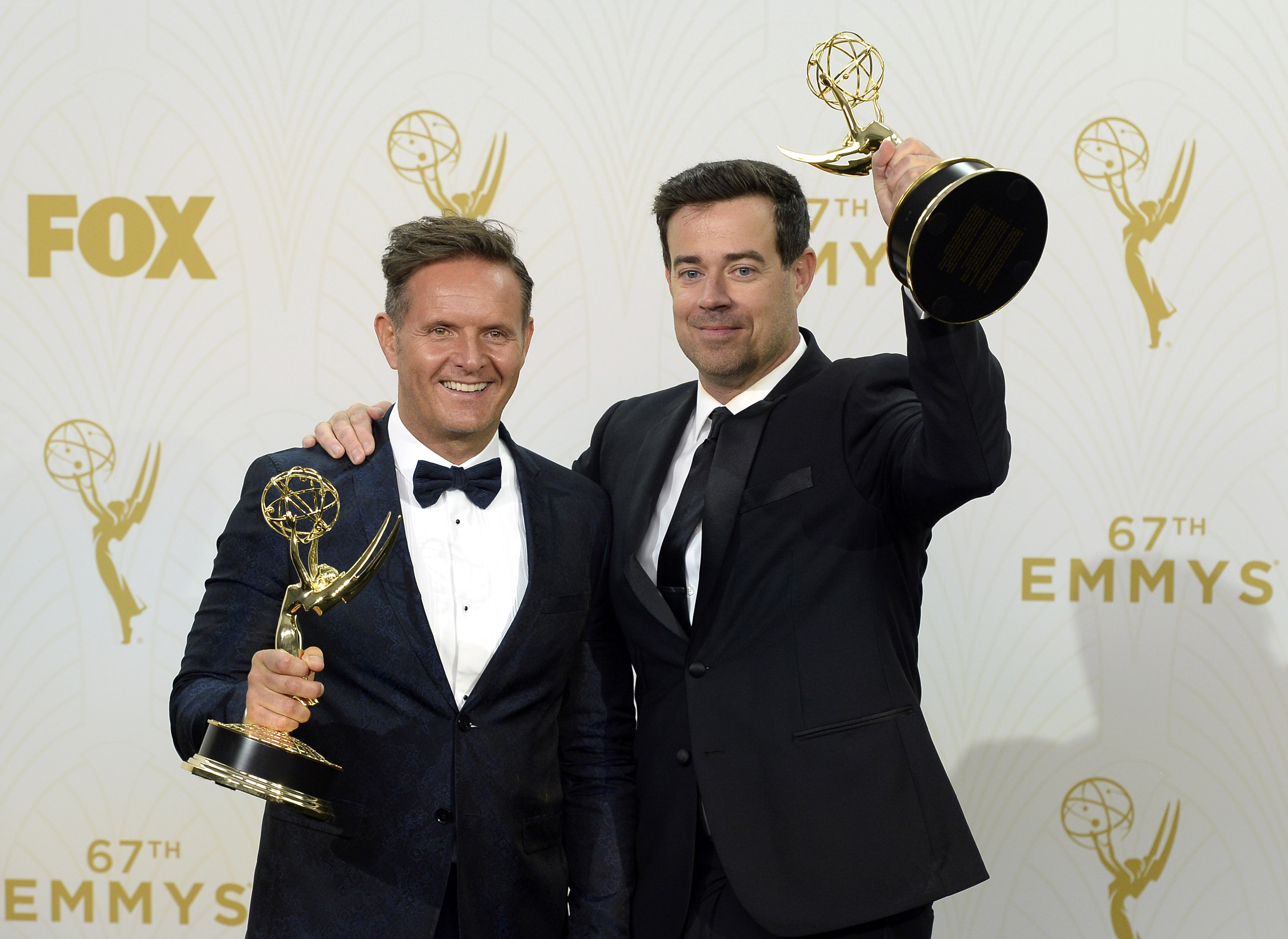 LOS ANGELES, CA - SEPTEMBER 20:  Producer Mark Burnett (L) and TV personality Carson Daly, winners of Outstanding Reality-Competition Program for 'The Voice', pose in the press room at the 67th Annual Primetime Emmy Awards at Microsoft Theater on September 20, 2015  in Los Angeles, California. (Photo by Kevork Djansezian/Getty Images)
