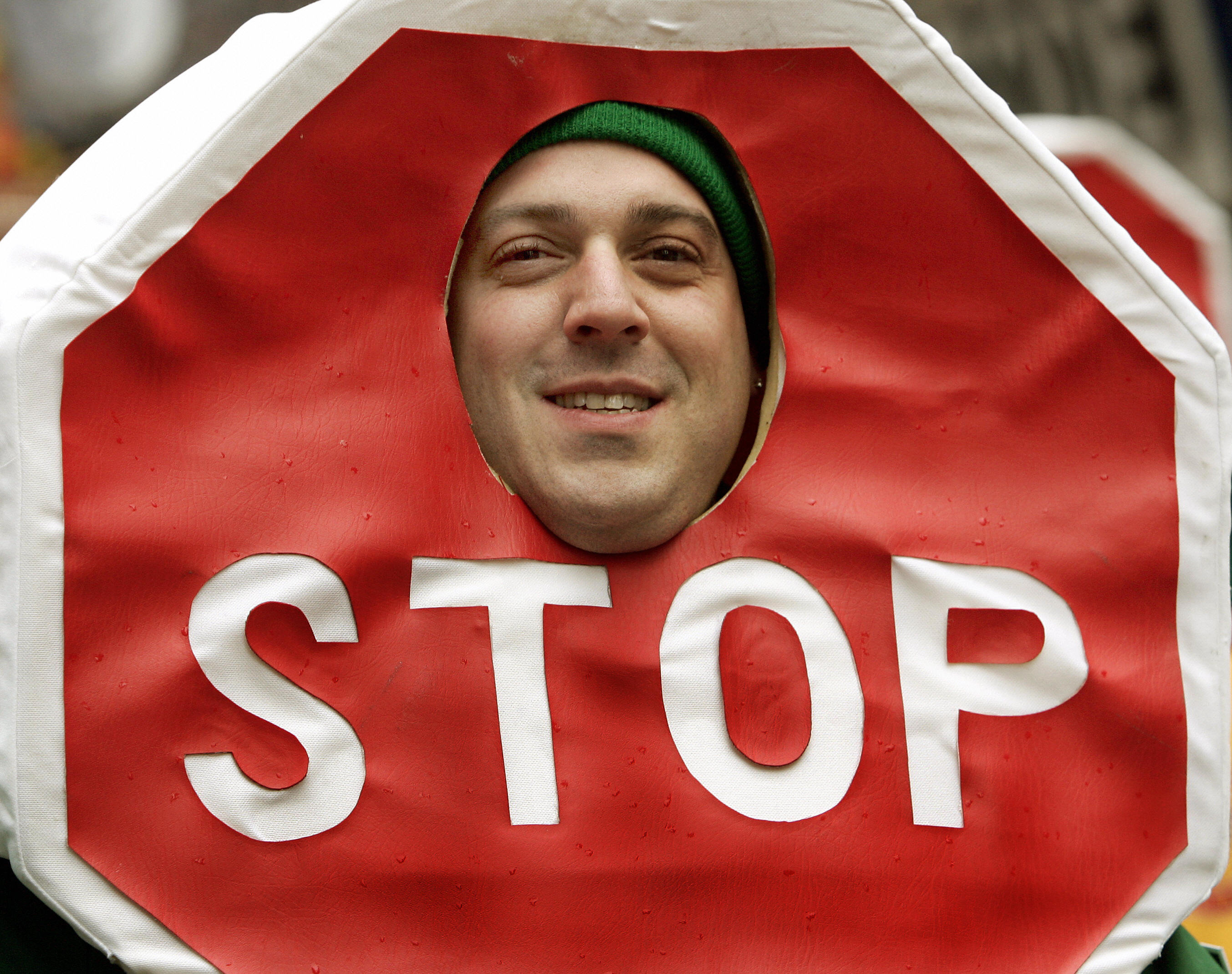 A parade marcher wearing a Stop Sign cos