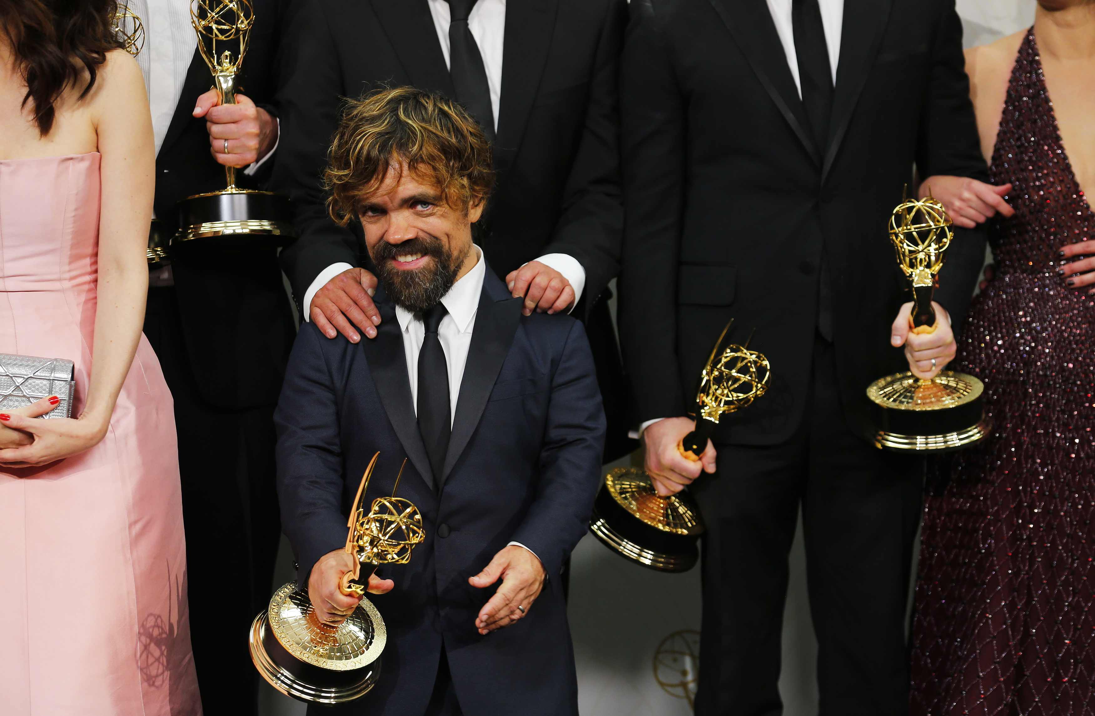 "Peter Dinklage and the cast of the ""Game of Thrones"" pose backstage with their Outstanding Drama Series award during the 67th Primetime Emmy Awards in Los Angeles"