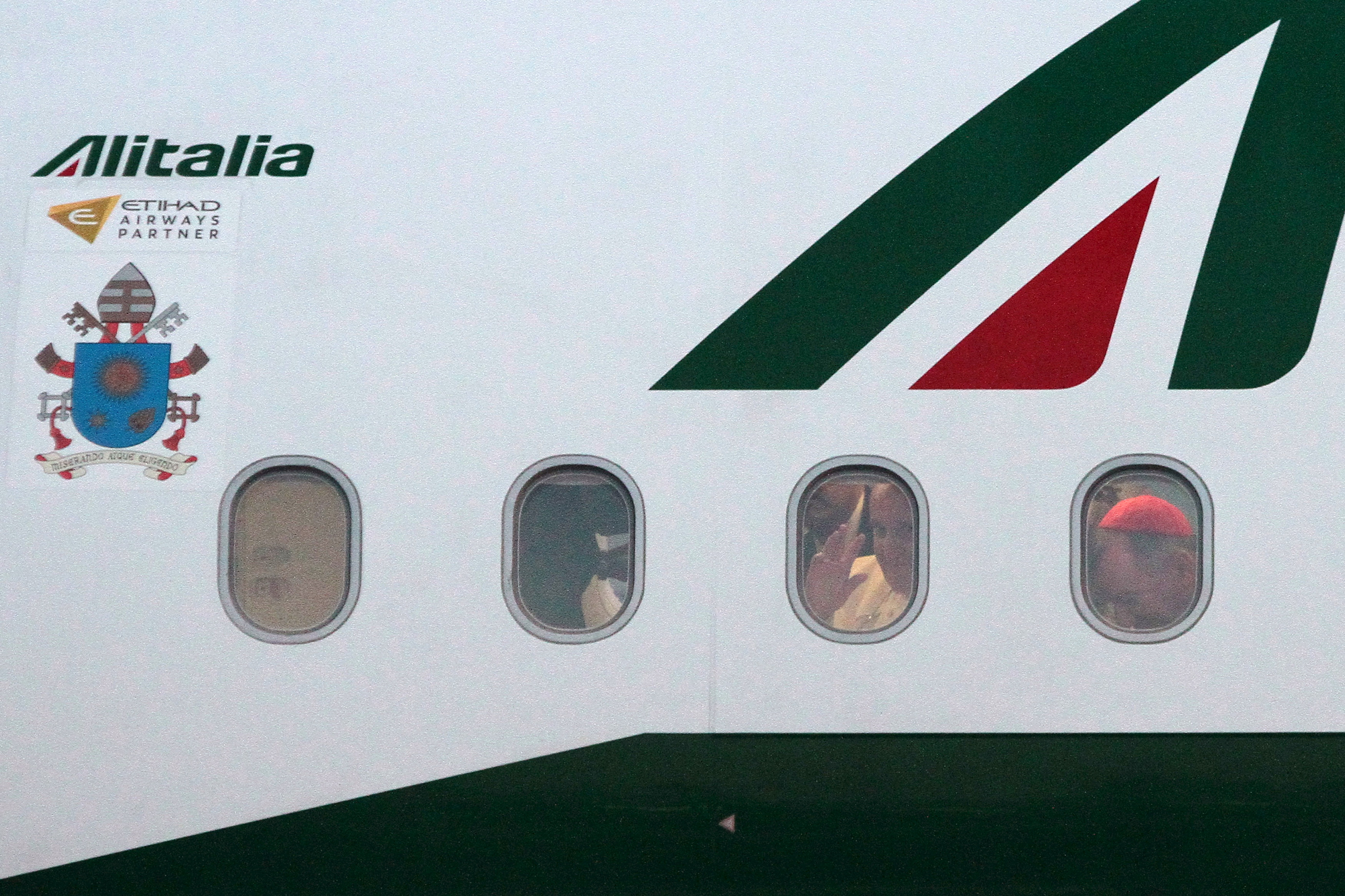 Pope Francis waves through window of airplane at the Sarajevo airport
