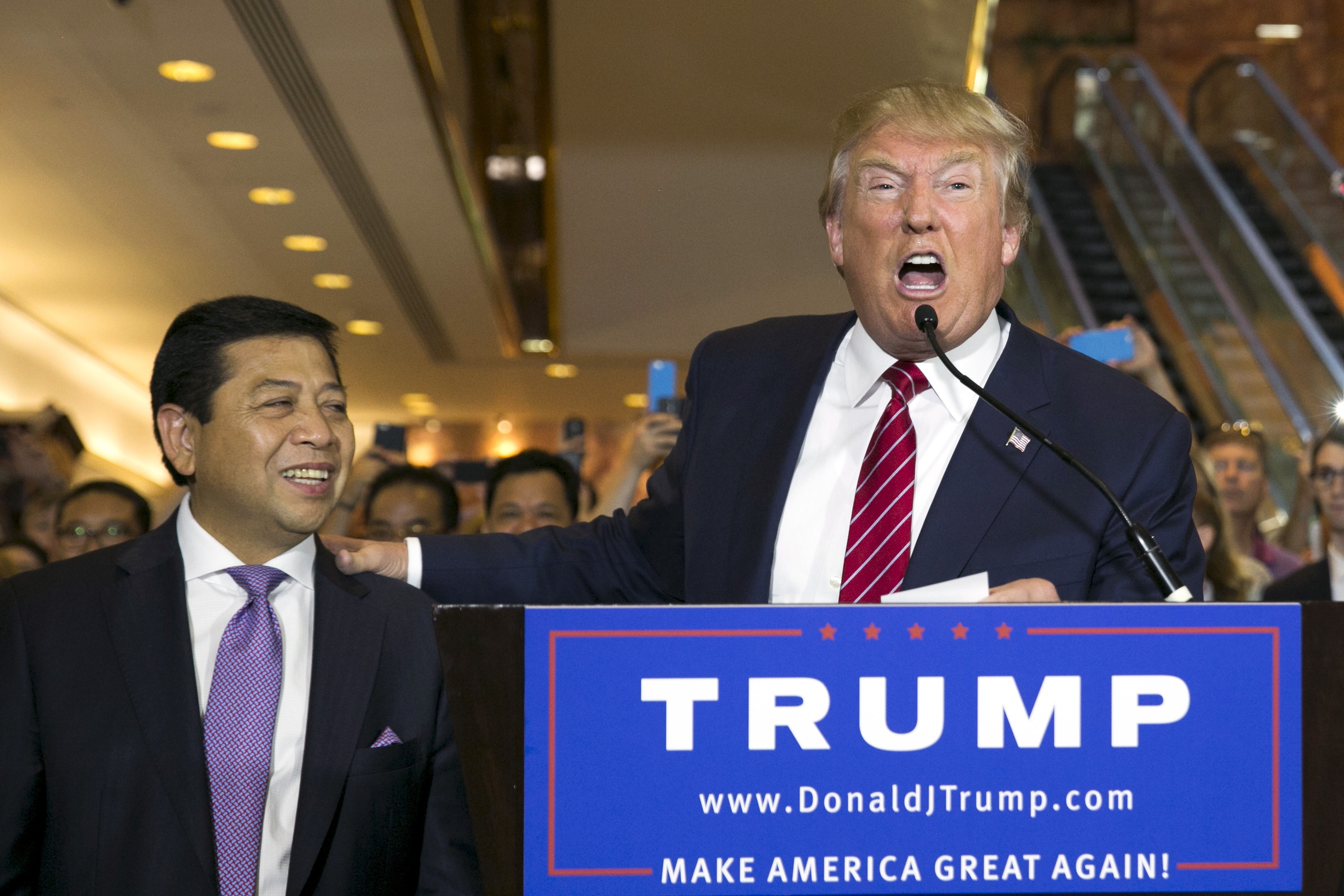 U.S. presidential hopeful Donald Trump (R) stands with Setya Novanto, Speaker of the House of Representatives of Indonesia, following a press availability after signing a pledge with the RNC at Trump Tower in Manhattan, New York