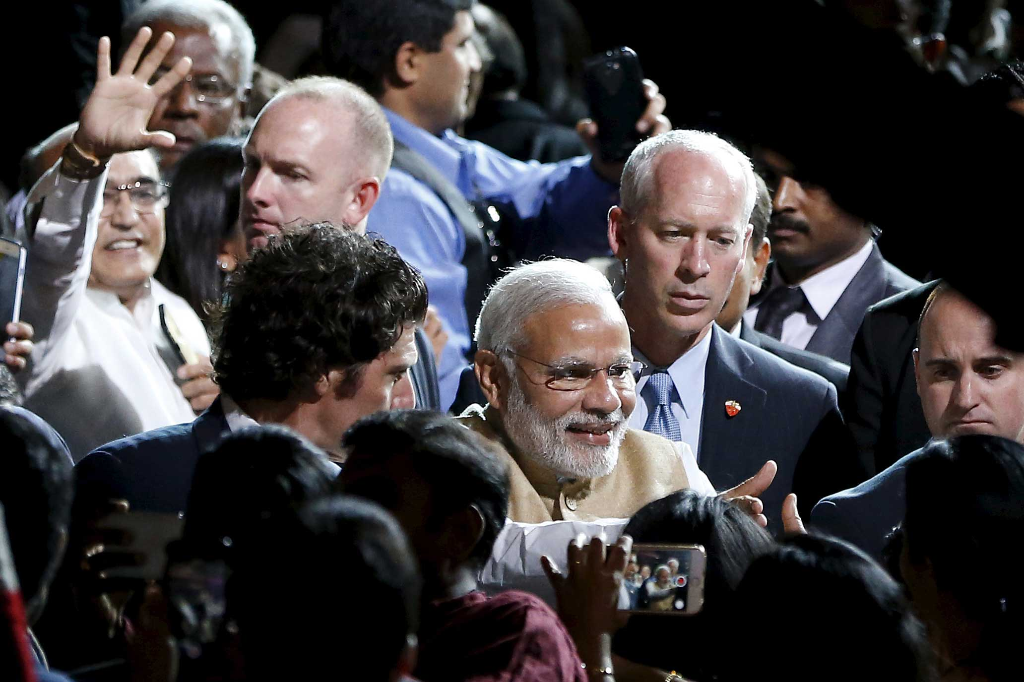 Indian PM Modi shakes hands with the crowd after speaking at a community reception at SAP Center in San Jose, California