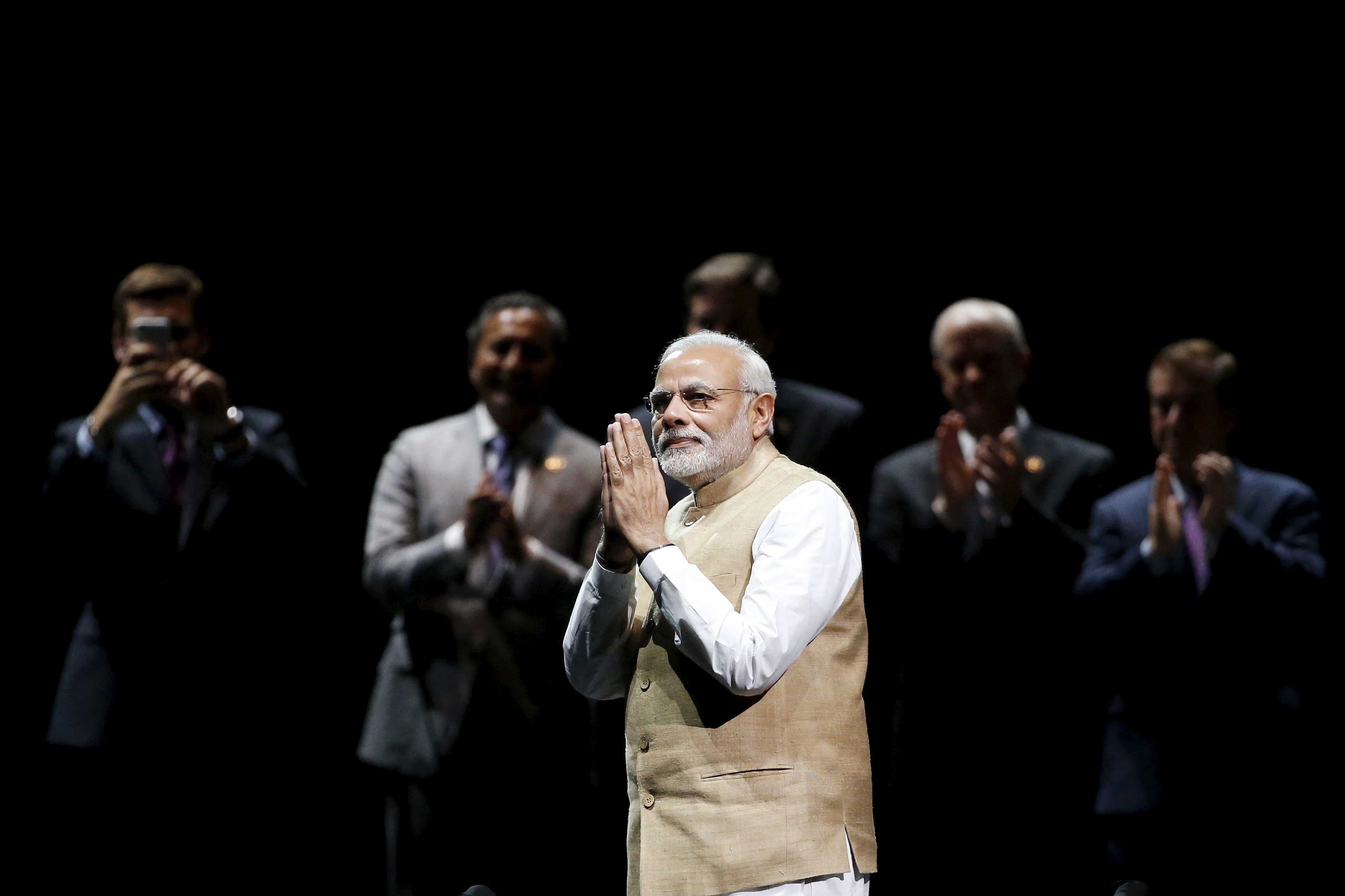 Indian PM Modi gestures during a community reception at SAP Center in San Jose, California