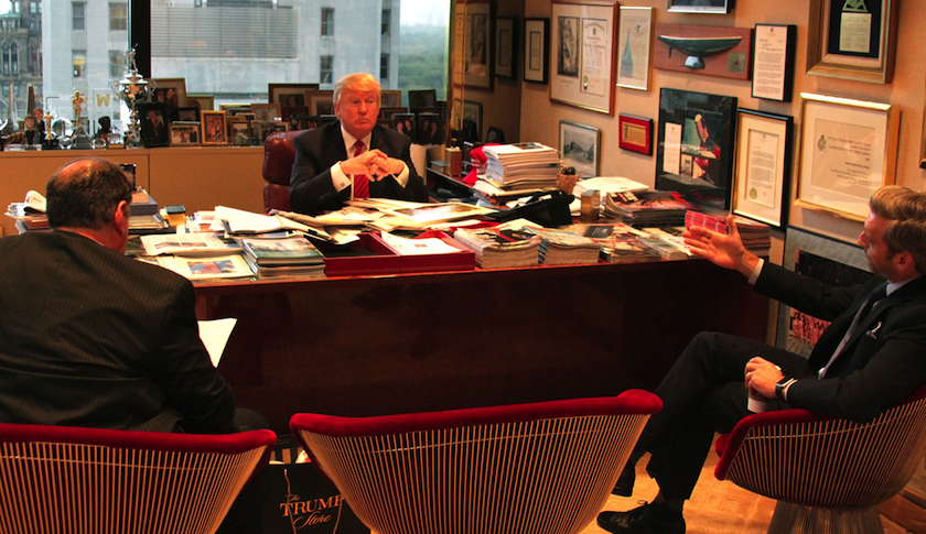 Donald Trump (center) with Jeffrey Sonnenfeld (left) and his Yale colleague Jacob Hacker (right) in Trump's office