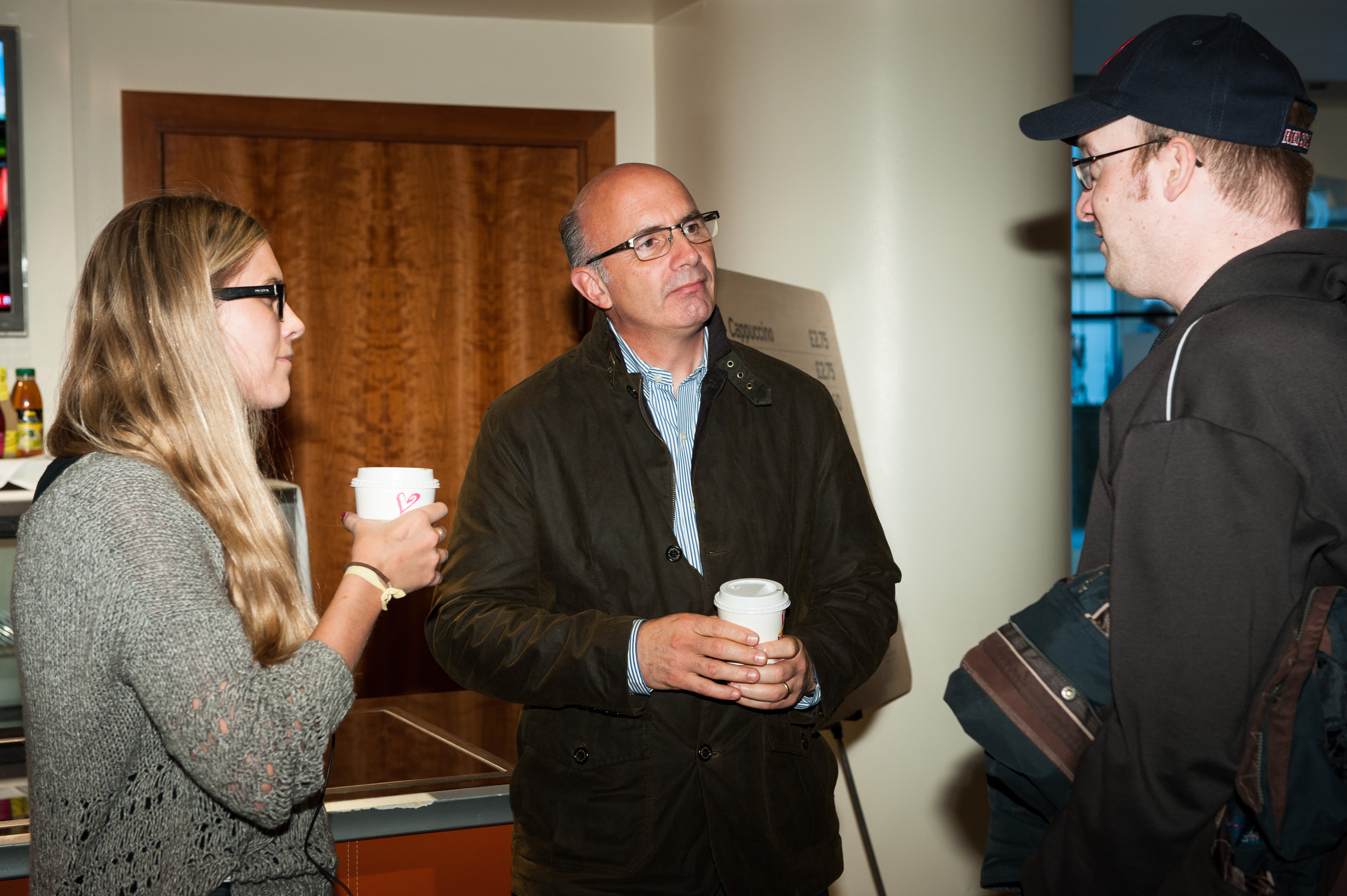 Open Invention Network CEO Keith Bergelt, center, speaks with Linux Foundation staffer Maresa Fowler, left, and OIN representative Armijn Hemel in 2013.