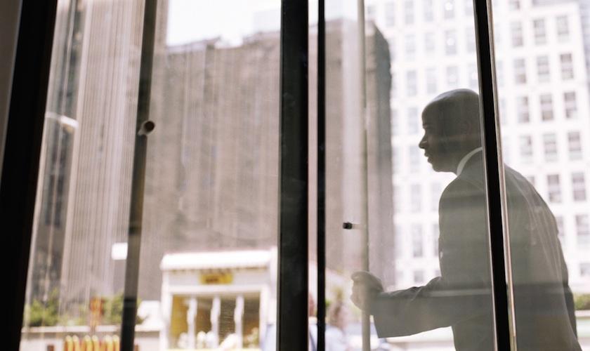 Businessman pushing through revolving doors