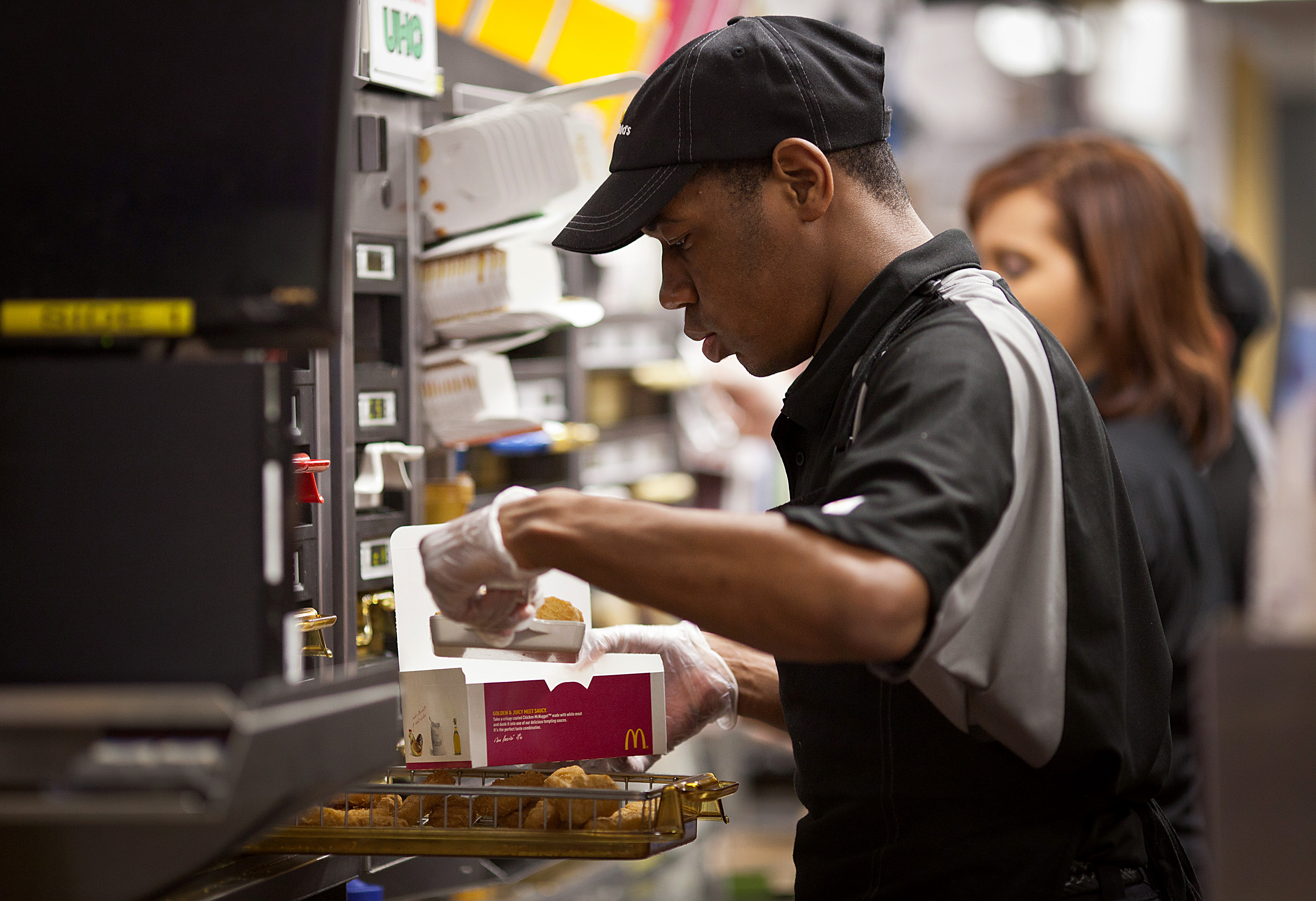 A worker puts together an order of Chicken McNuggets at a McDonald's Corp. restaurant in Little Falls, New Jersey, U.S.