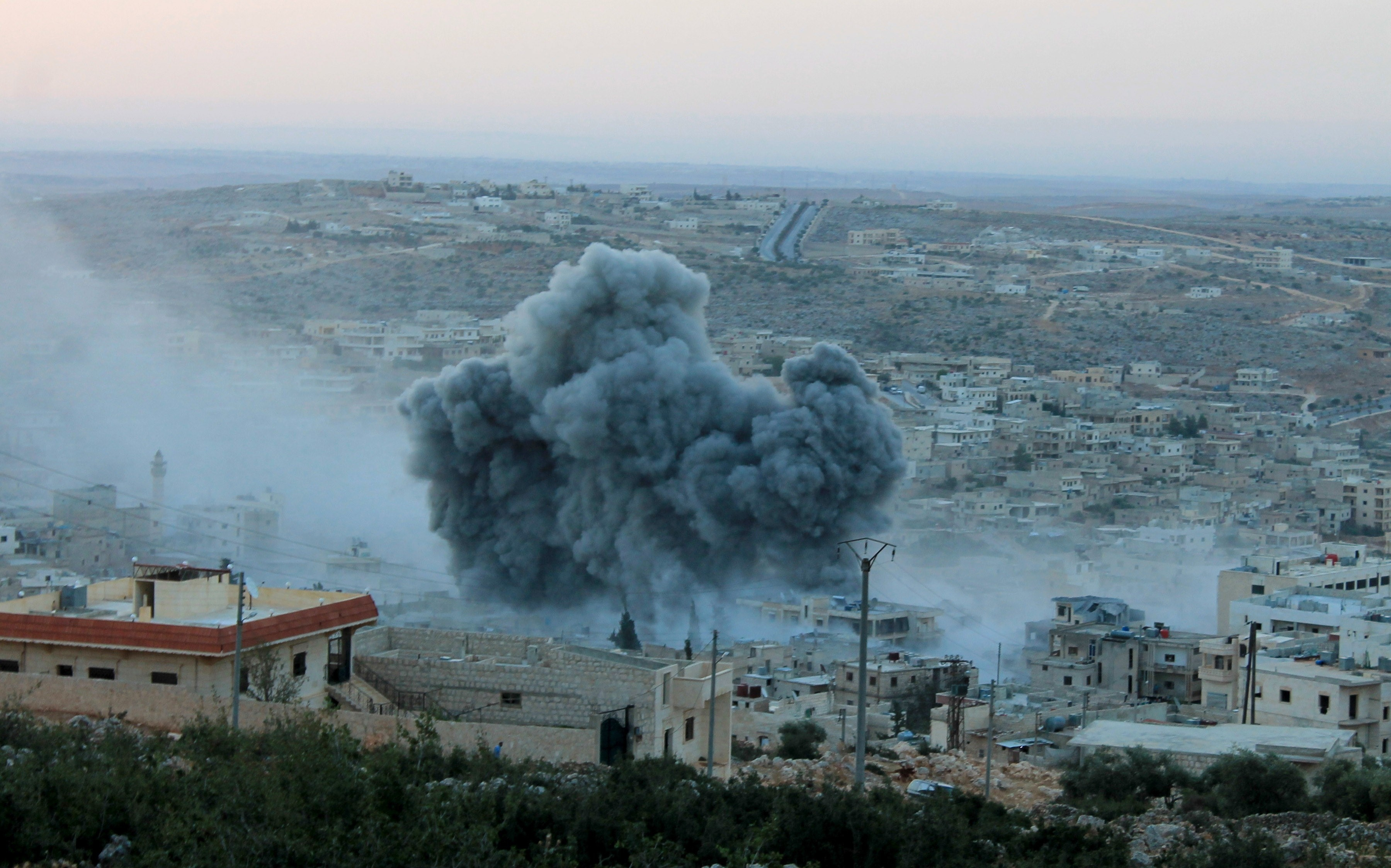Smoke rises after Russian war crafts hit the Syrian opposition controlled town Daret Ezza in Aleppo, Syria Tuesday.