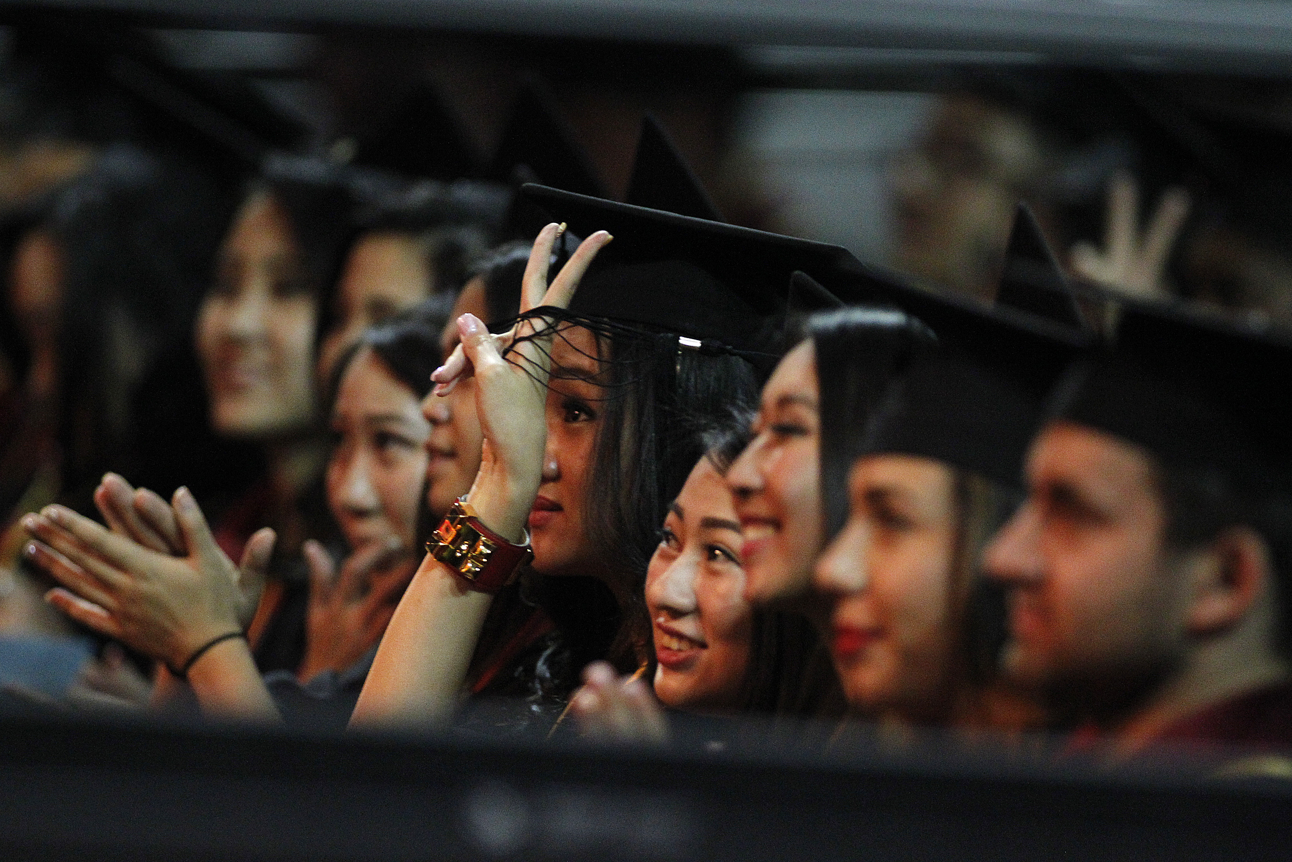LOS ANGELES, CA.-MAY 16, 2014:  USC Marshall School of Business graduates cheer after listening to t