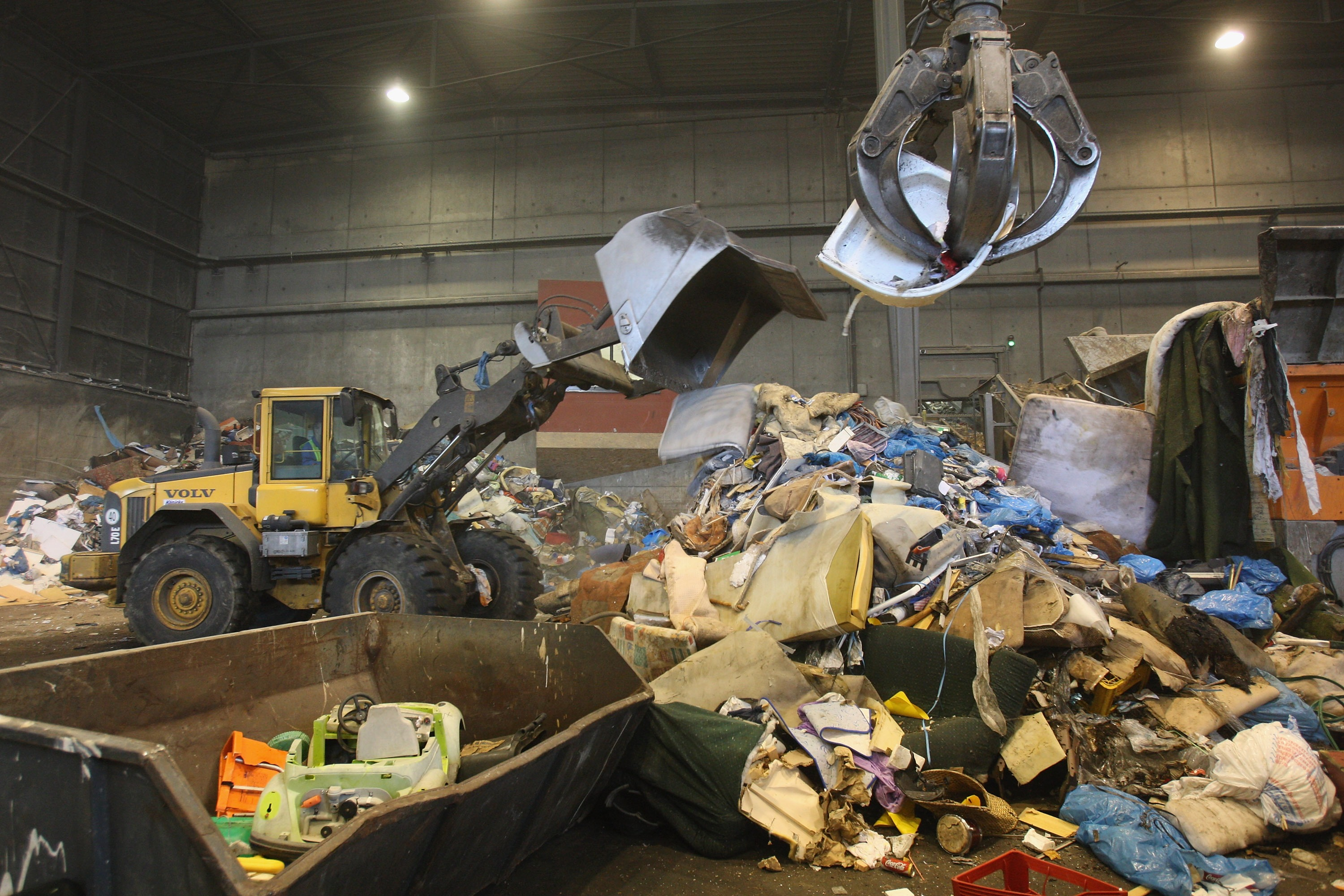 Crews sort garbage at a processing center in Nuemuenster, Germany for consumption in the city's converted power plant.