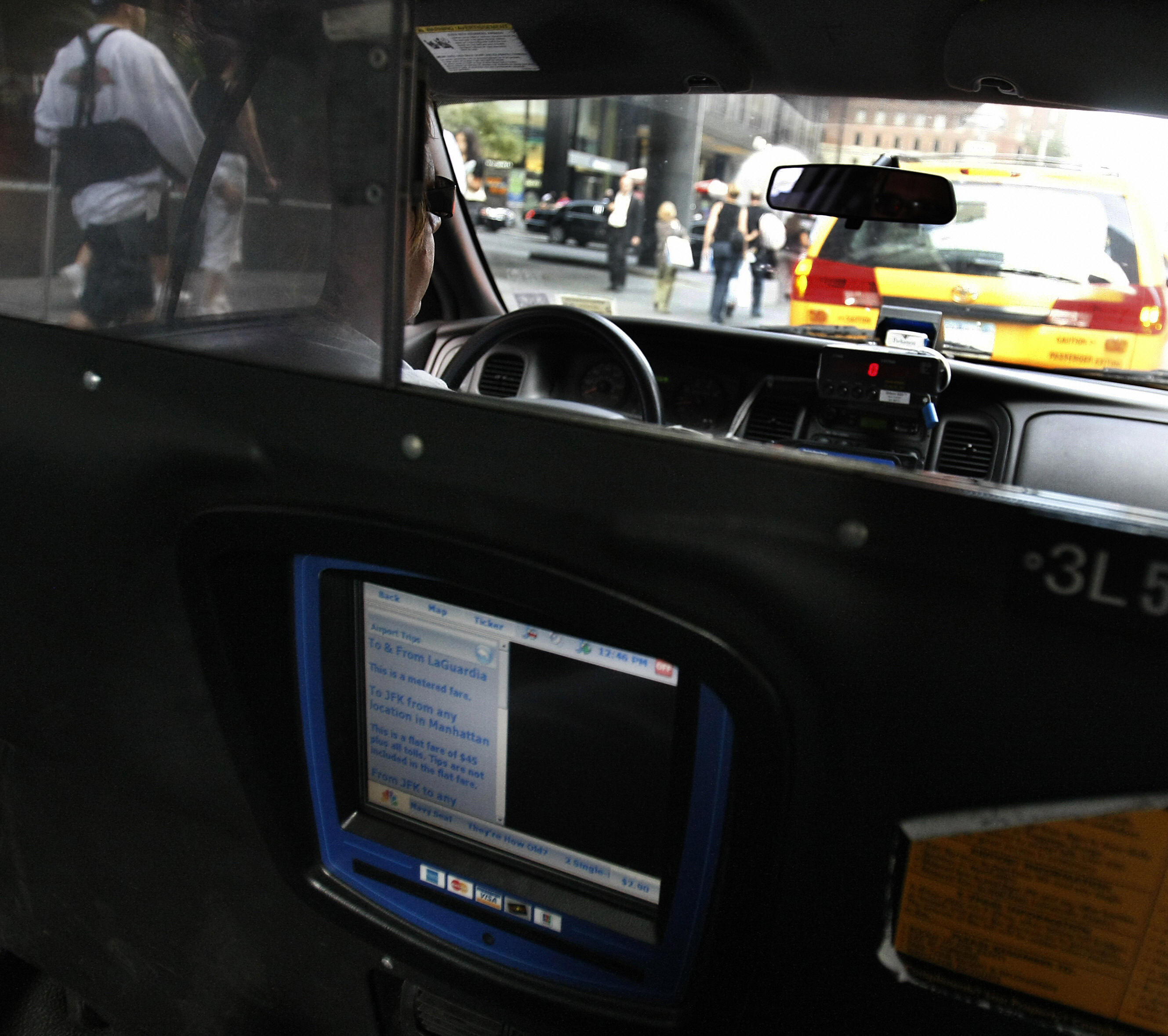 A New York City cab driver waits in line
