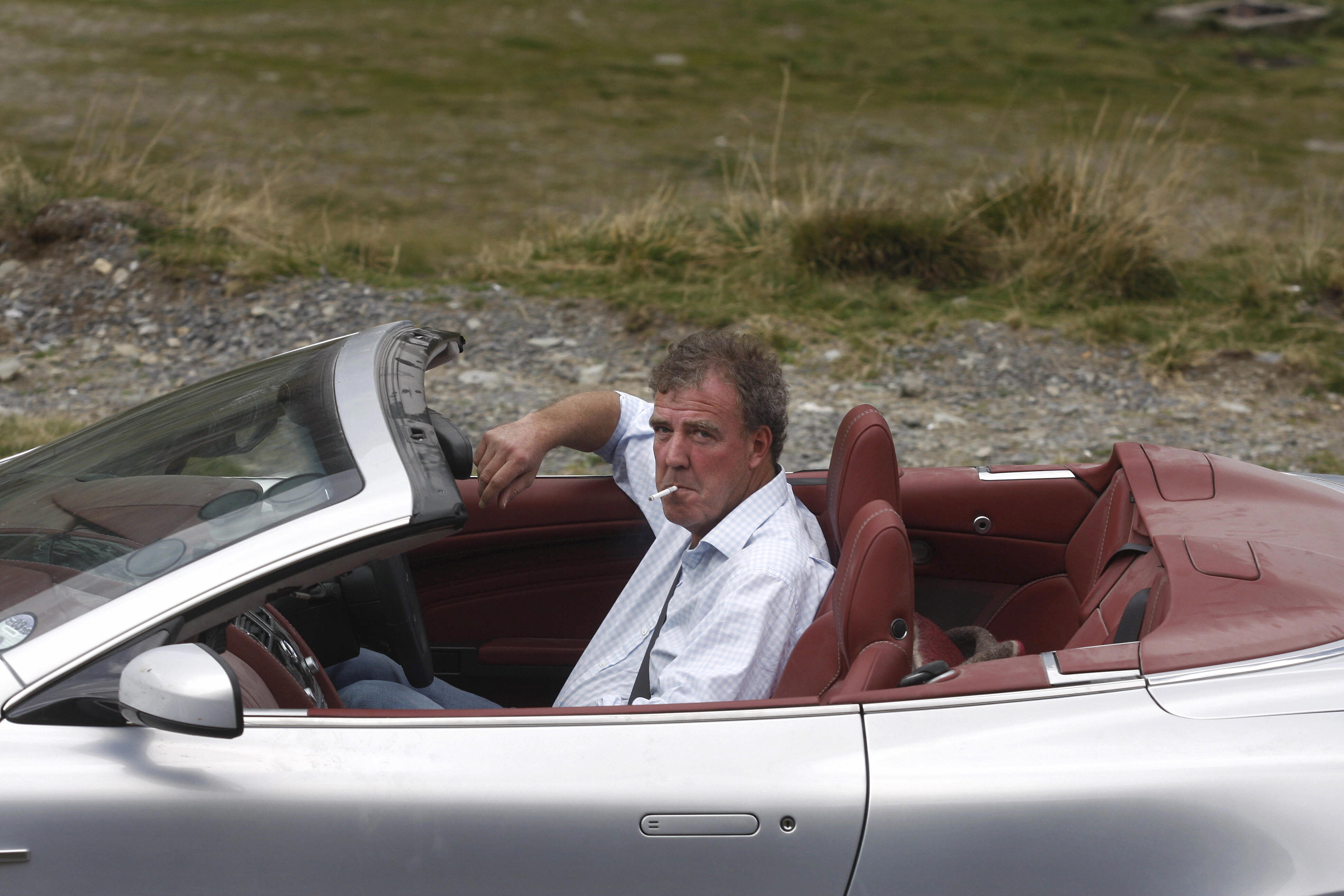 British television BBC presenter of motor show 'Top Gear' Jeremy Clarkson is pictured while he drives an Aston Martin car on Transfagarasan road close to Sibiu city, 300 km northwest from Bucharest, on September 24, 2009.
