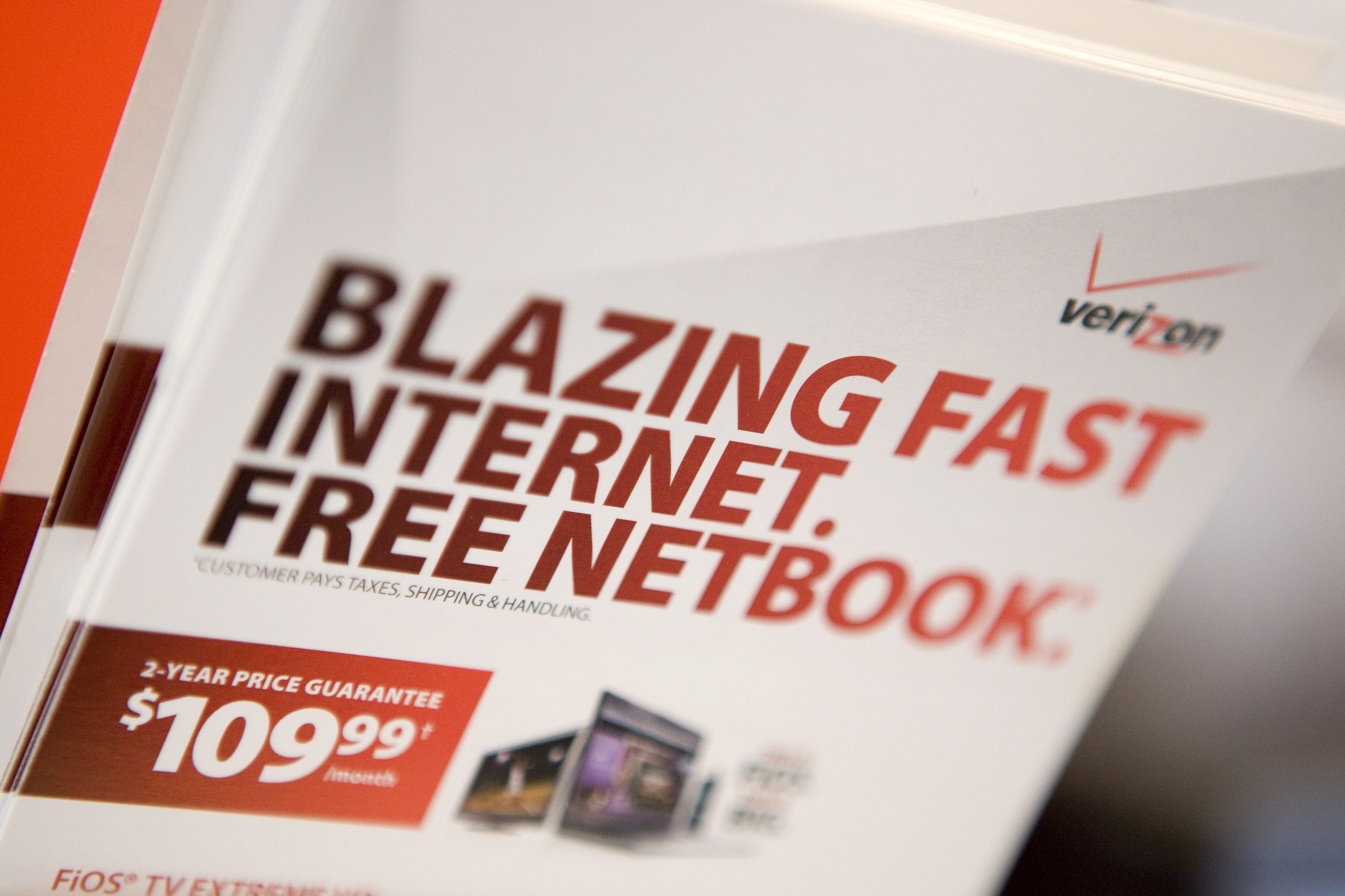 Brochures for Verizon FiOS and a free netbook sit inside a Verizon Wireless store in New York, U.S.