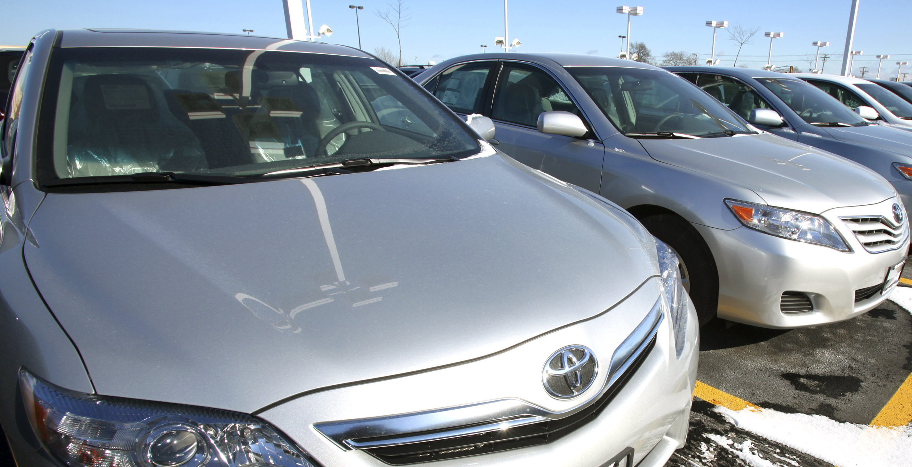 Toyota Camrys sit on the sales lot at Bredemann Toyota in Park Ridge, Illinois, U.S.
