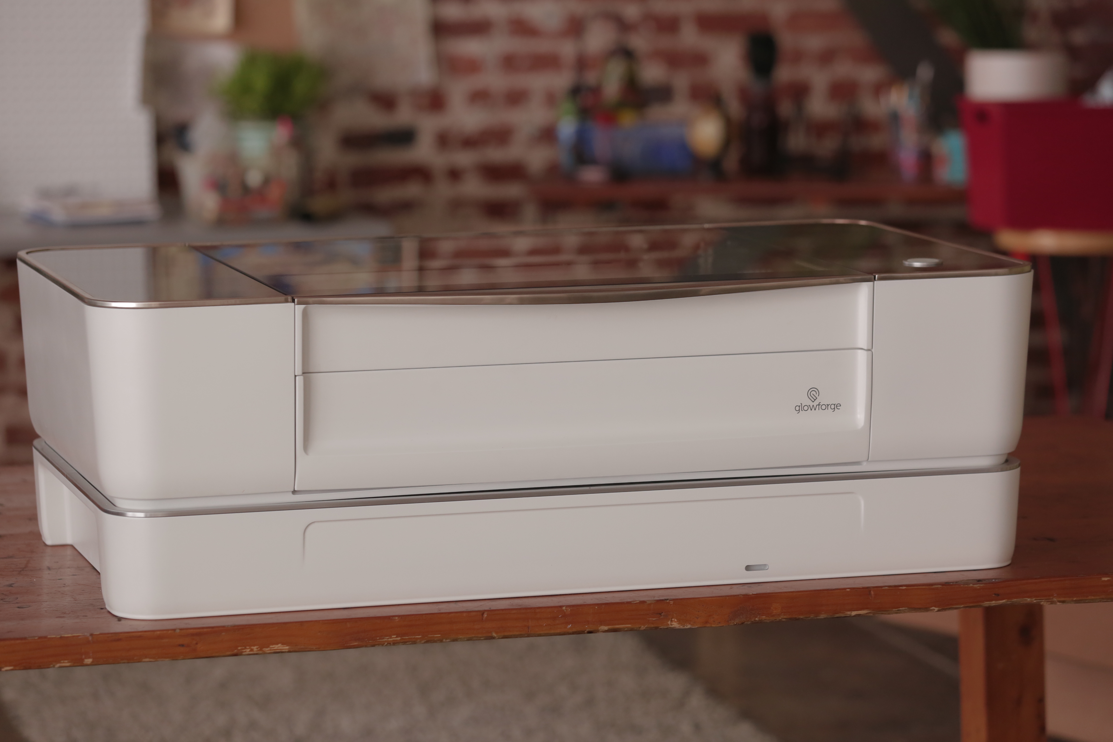 The Glowforge laser cutter with air filter attached underneath.