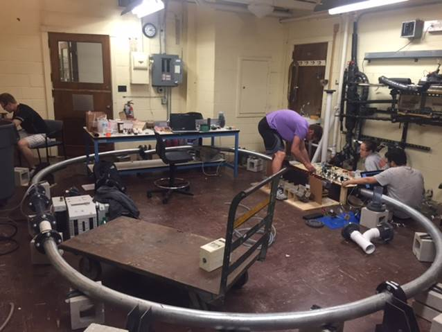 The University of Illinois Hyperloop team working on a scale model.