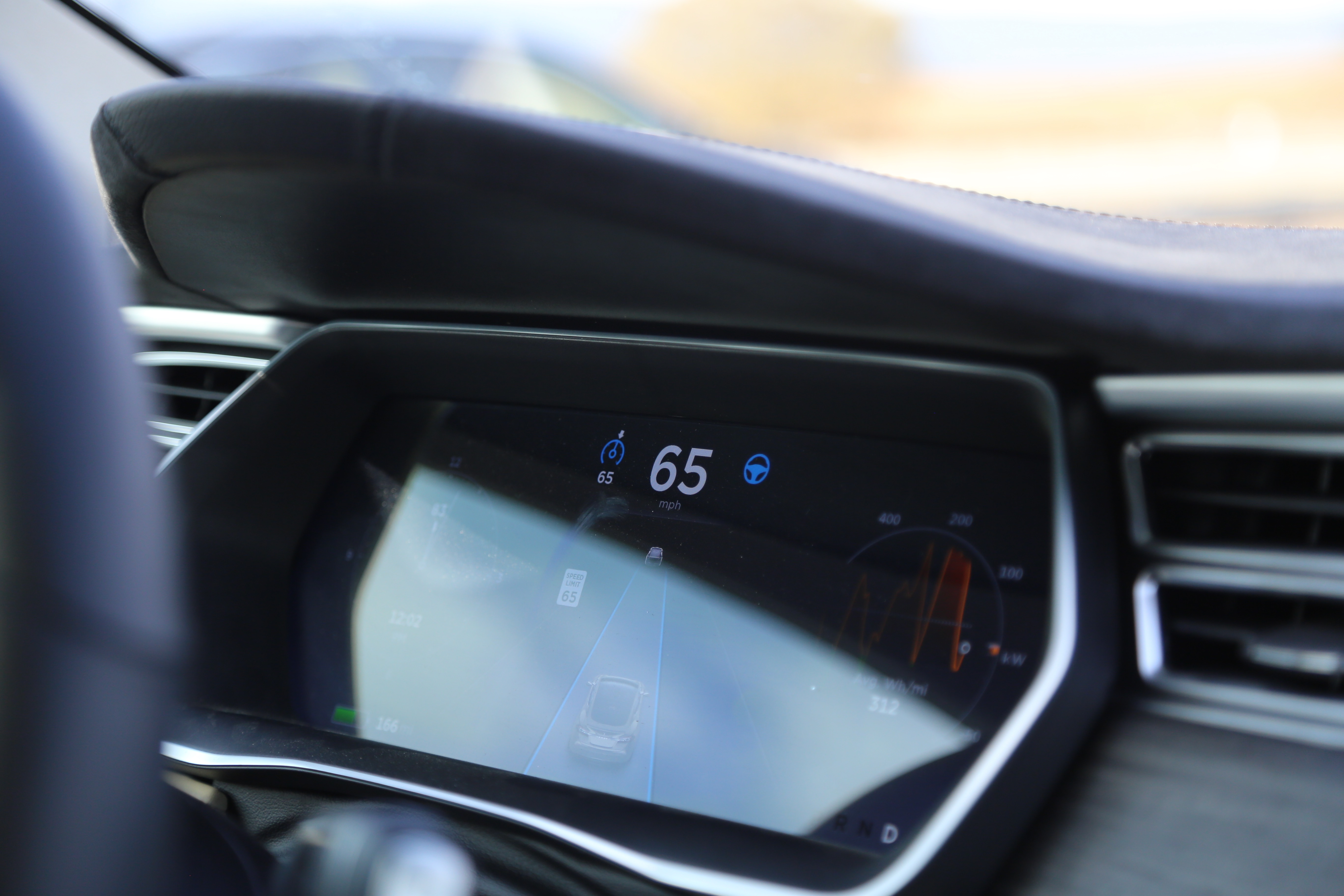Tesla's autopilot manages speed by using active, traffic-aware cruise control.