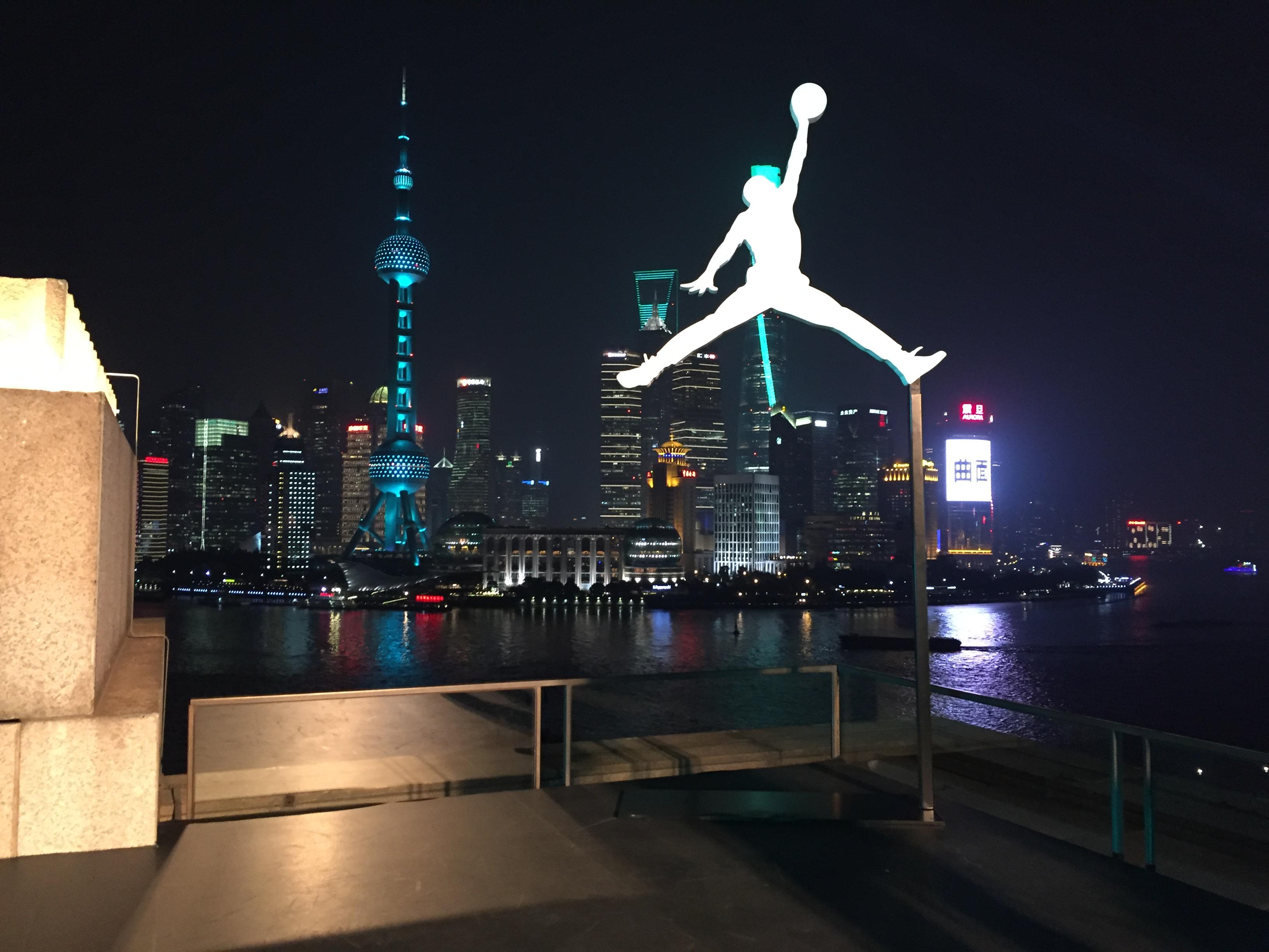 The Jordan Brand logo silhouetted against Shanghai's skyline.
