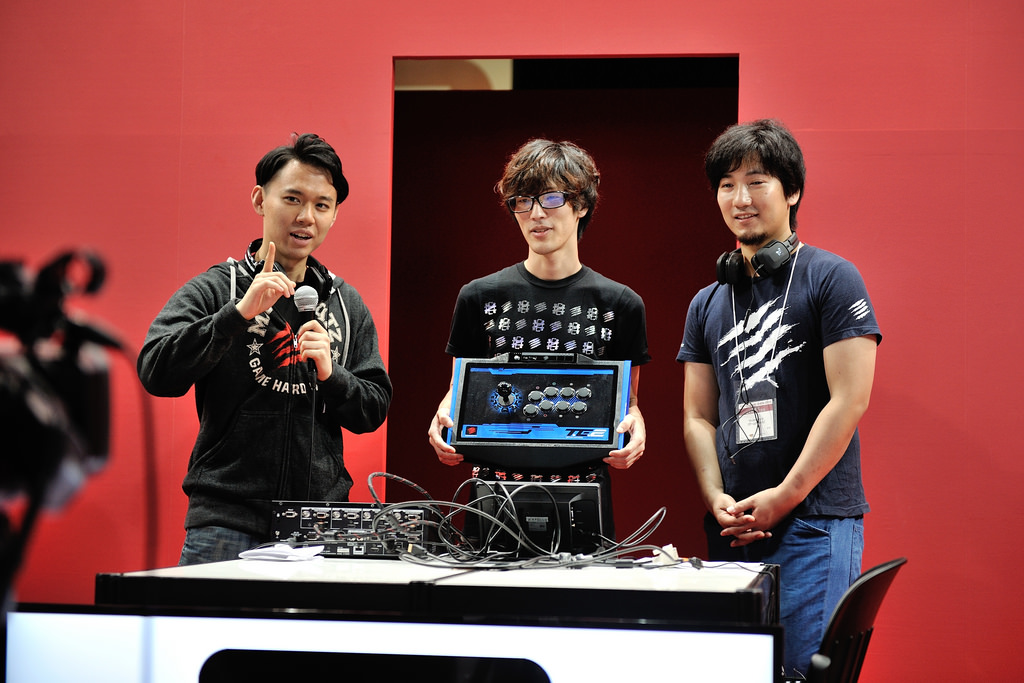 "Mad Catz is banking on the ""Michael Jordan"" effect as pro gamers like (from left) Hajime Taniguchi, Kenryo Hayashi, and Daigo Umehara use its products."