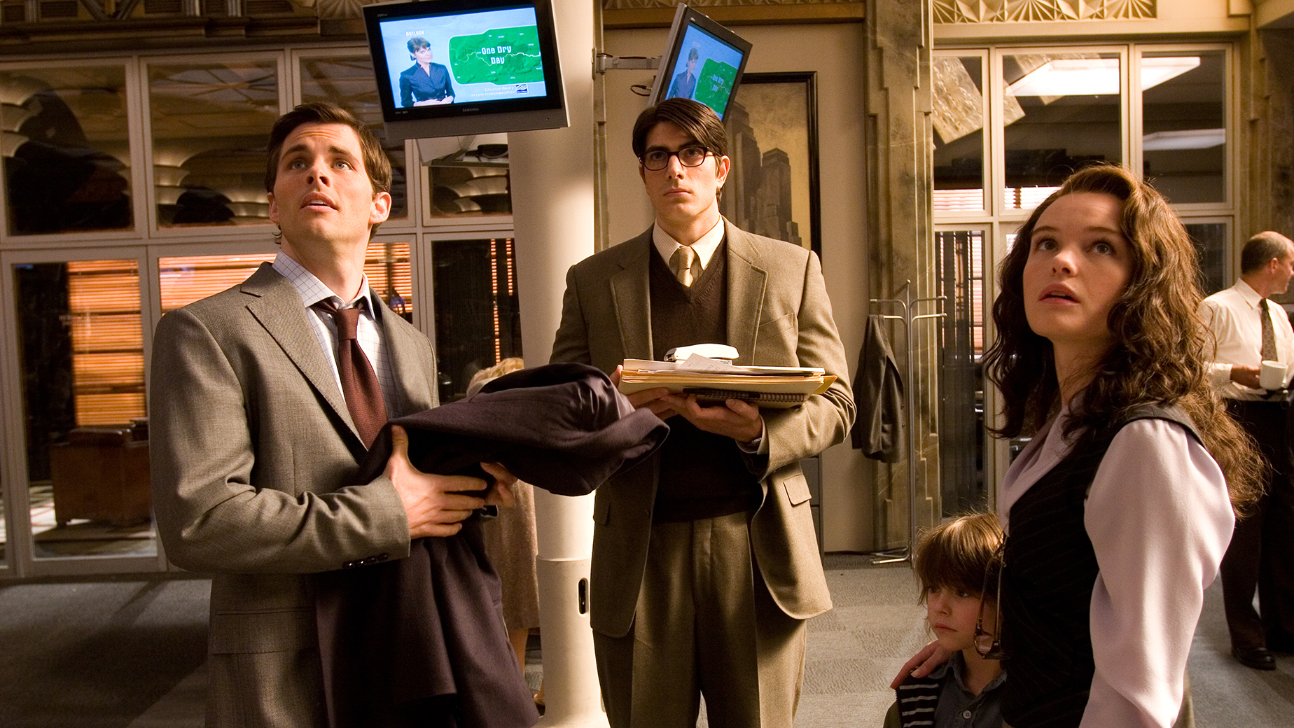 (left to right) Lois Lane's fiancé Richard White (JAMES MARSDEN) along with Clark Kent (BRANDON ROUTH), Lois's son Jason (TRISTAN LAKE LEABU) and Lois herself (KATE BOSWORTH) work after hours at the Daily Planet to cover the story of the century, the return of Superman, in Warner Bros. Pictures' and Legendary Pictures' action adventure Superman Returns.PHOTOGRAPHS TO BE USED SOLELY FOR ADVERTISING, PROMOTION, PUBLICITY OR REVIEWS OF THIS SPECIFIC MOTION PICTURE AND TO REMAIN THE PROPERTY OF THE STUDIO. NOT FOR SALE OR REDISTRIBUTION. ALL RIGHTS RESERVED.