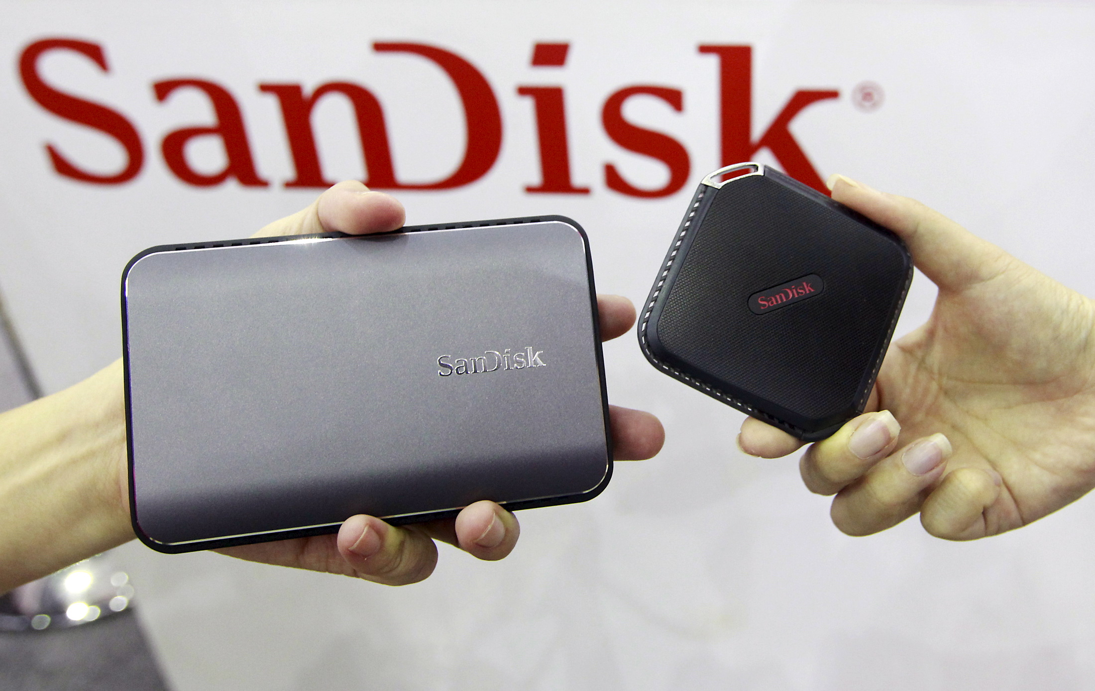 Sandisk's new portable solid state drives are displayed at the Sandisk booth during the 2015 Computex exhibition at the TWTC Nangang exhibition hall in Taipei, Taiwan