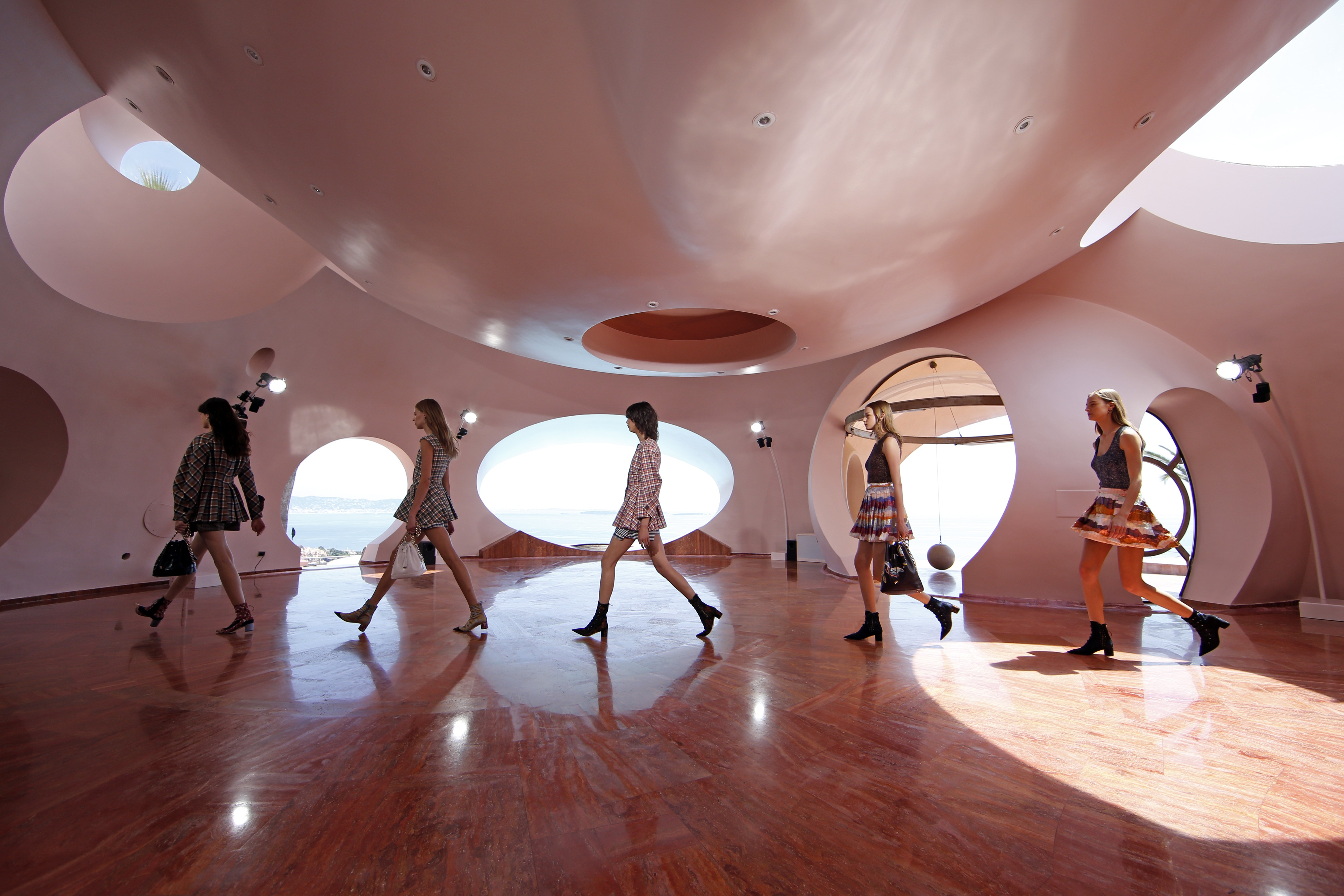 Models present creations by Belgian designer Raf Simons for Dior's women CRUISE 2016 collection during a fashion show at the Palais Bulle in Theoule-sur-Mer, near Cannes