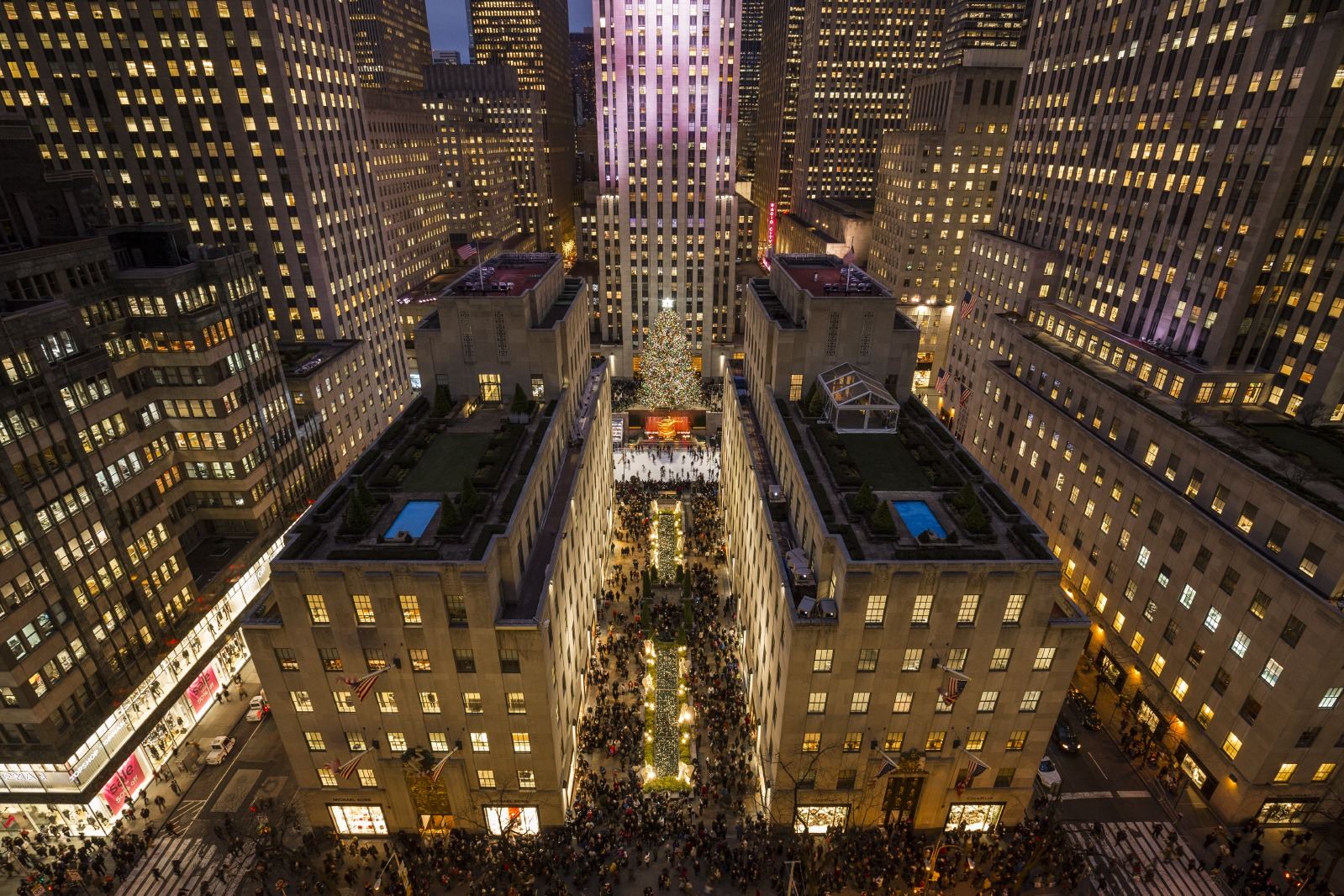 Here's the heart of Rockefeller Center, the Art Deco complex that John D. Rockefeller, Jr., spent the entire decade of the 1930s building with his architect, Raymond Hood. We are looking directly down on the Channel Gardens, which lead pedestrians from Fifth Avenue, left, to the plaza in front of the GE Building (aka 30 Rock), which was being used by a café when this photograph was taken in May, but becomes a skating rink in winter. The small platform with scaffolding, right, where the Christmas tree stands tall in December, is being readied for the installation of a sculpture by Jeff Koons. Some of the buildings have exquisite rooftop gardens kept mostly for the pleasure of people who work in the complex.