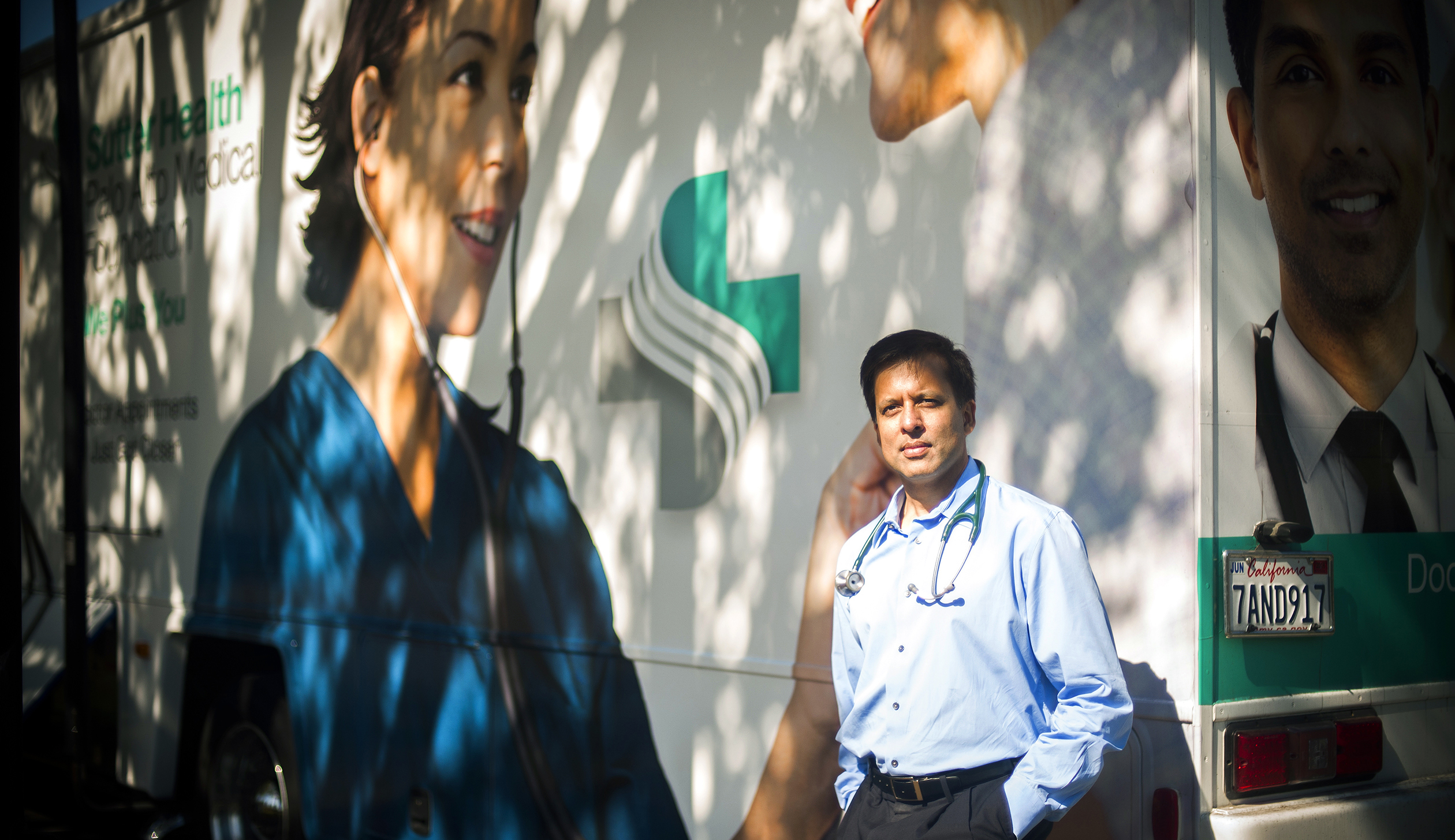 "Milpitas, California - October 1: Dr. Ronesh Sinha, photographed outside Sutter Health's ""Care-A-Van"" which travels to a variety of sillicon valley companies, providing on site exams."