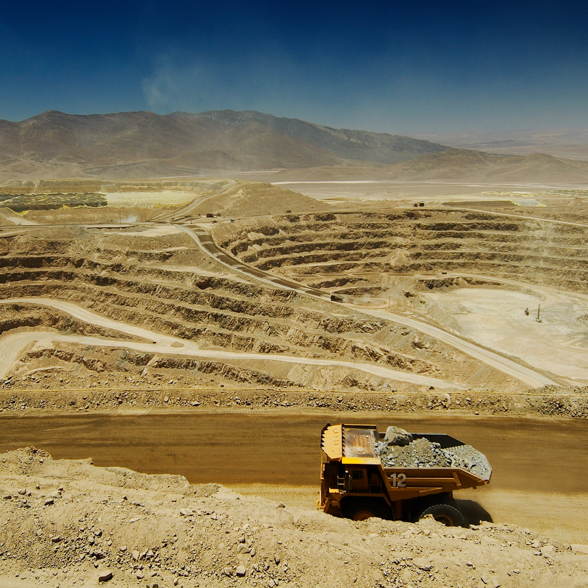 A truck hauls ore at Lomas Bayas open pit mine, Chile