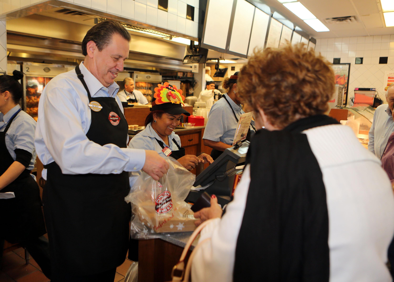 Boston Market CEO George Michel Works at Miami-area restaurant o