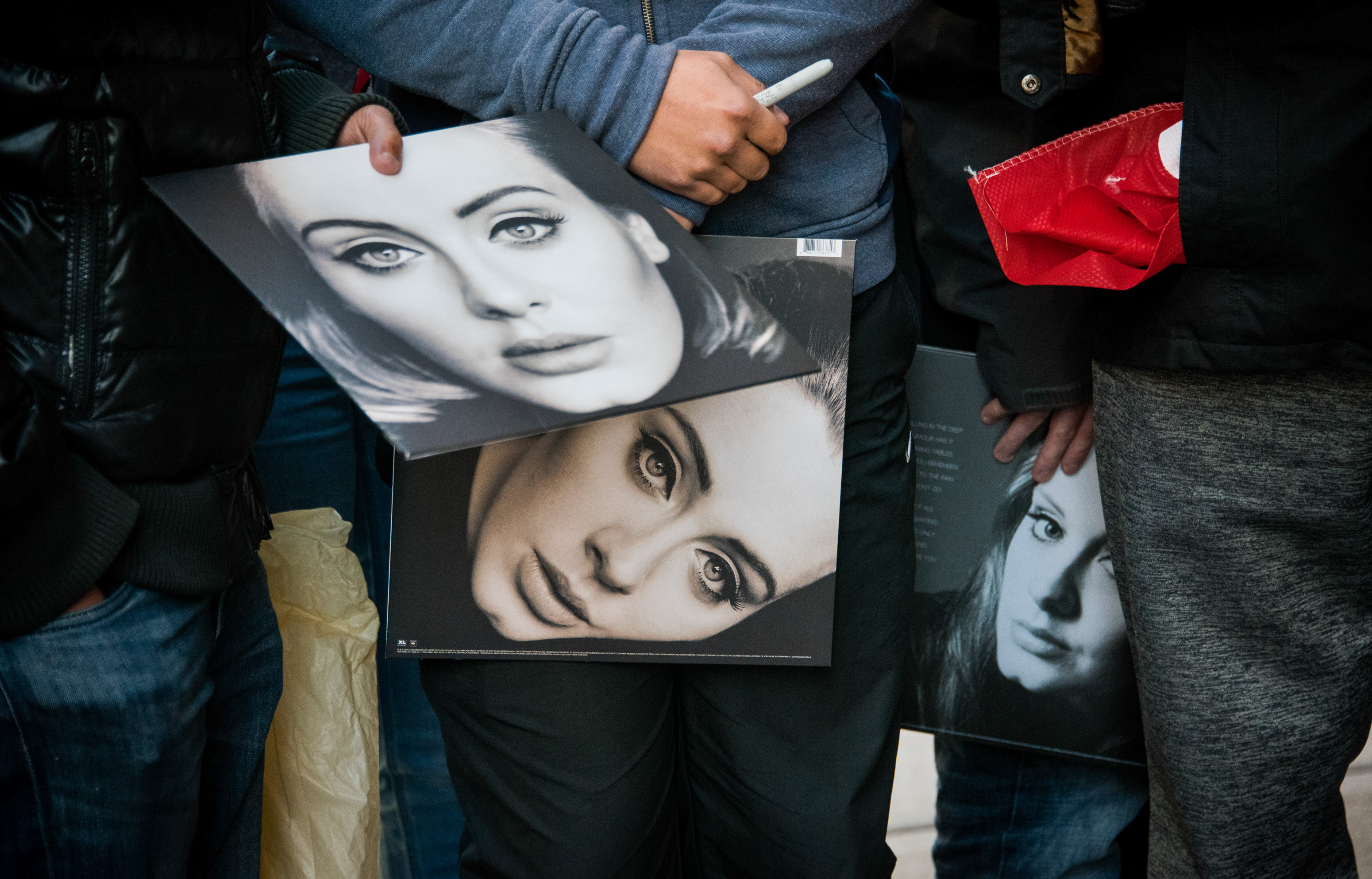 Fans wait to see Adele on Nov. 20 in New York City.