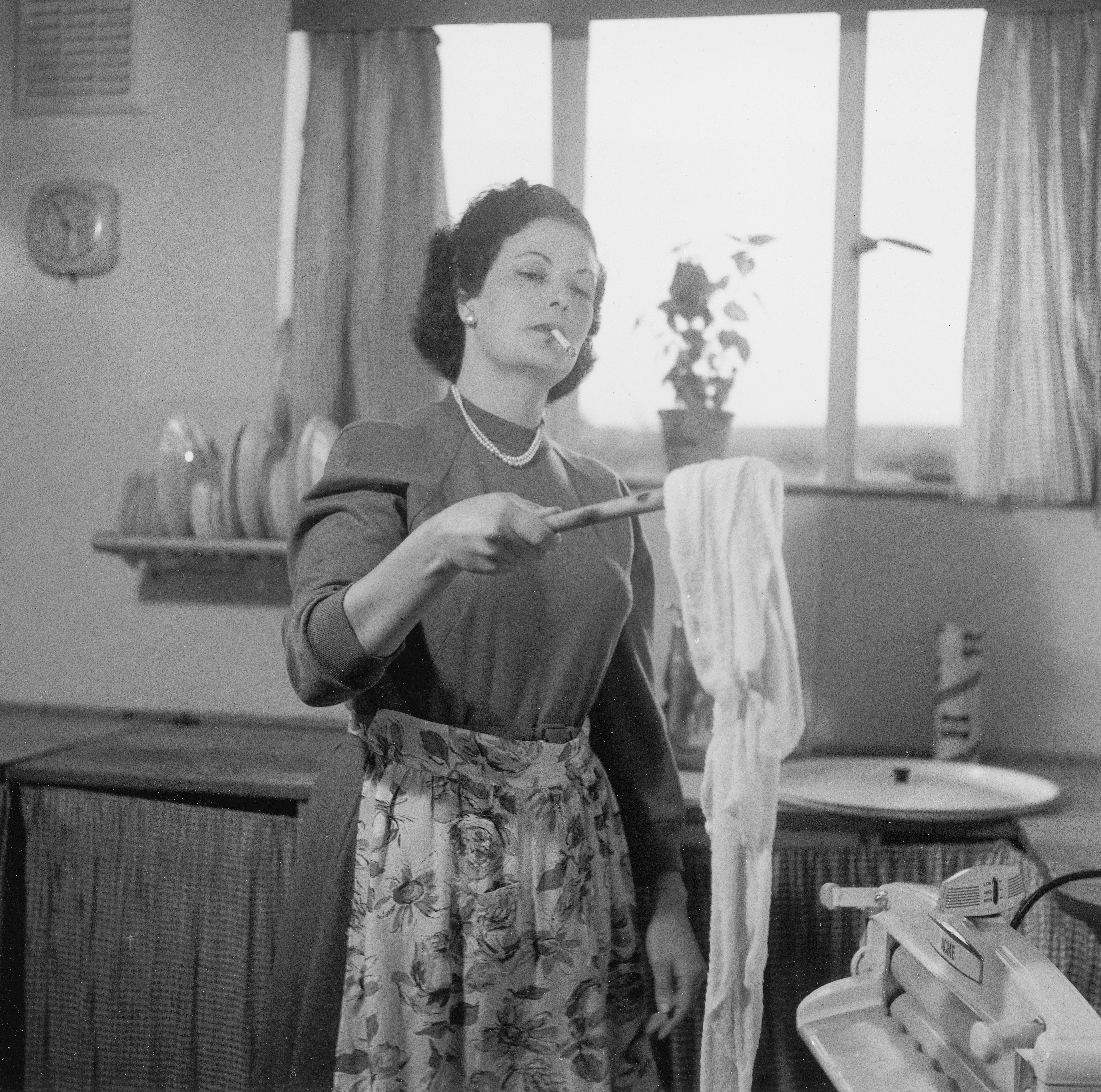 Housewife doing the laundry, 1954.