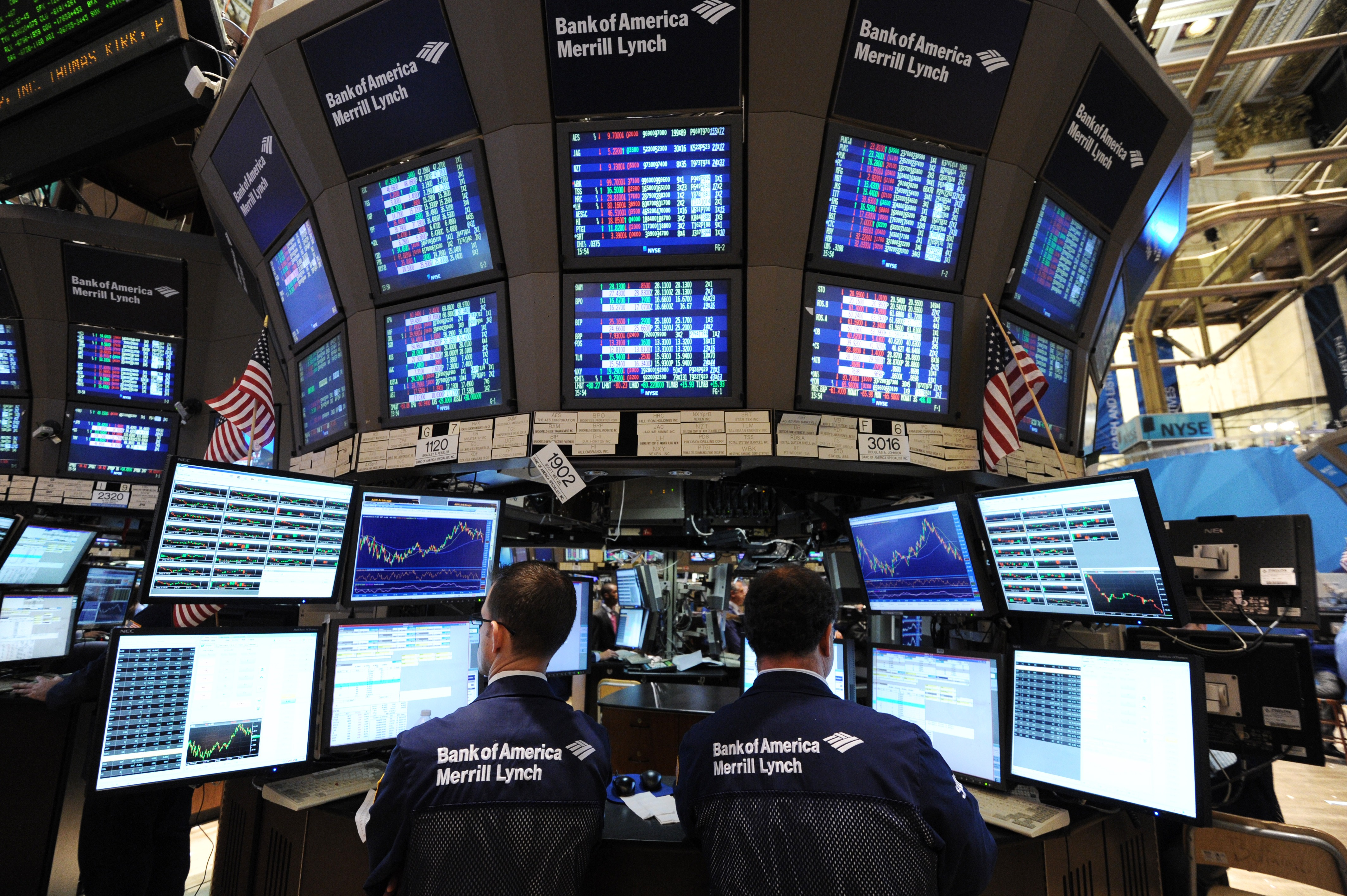 Stock specialists work at the Bank of America/Merrill Lynch post on the floor of the New York Stock Exchange.