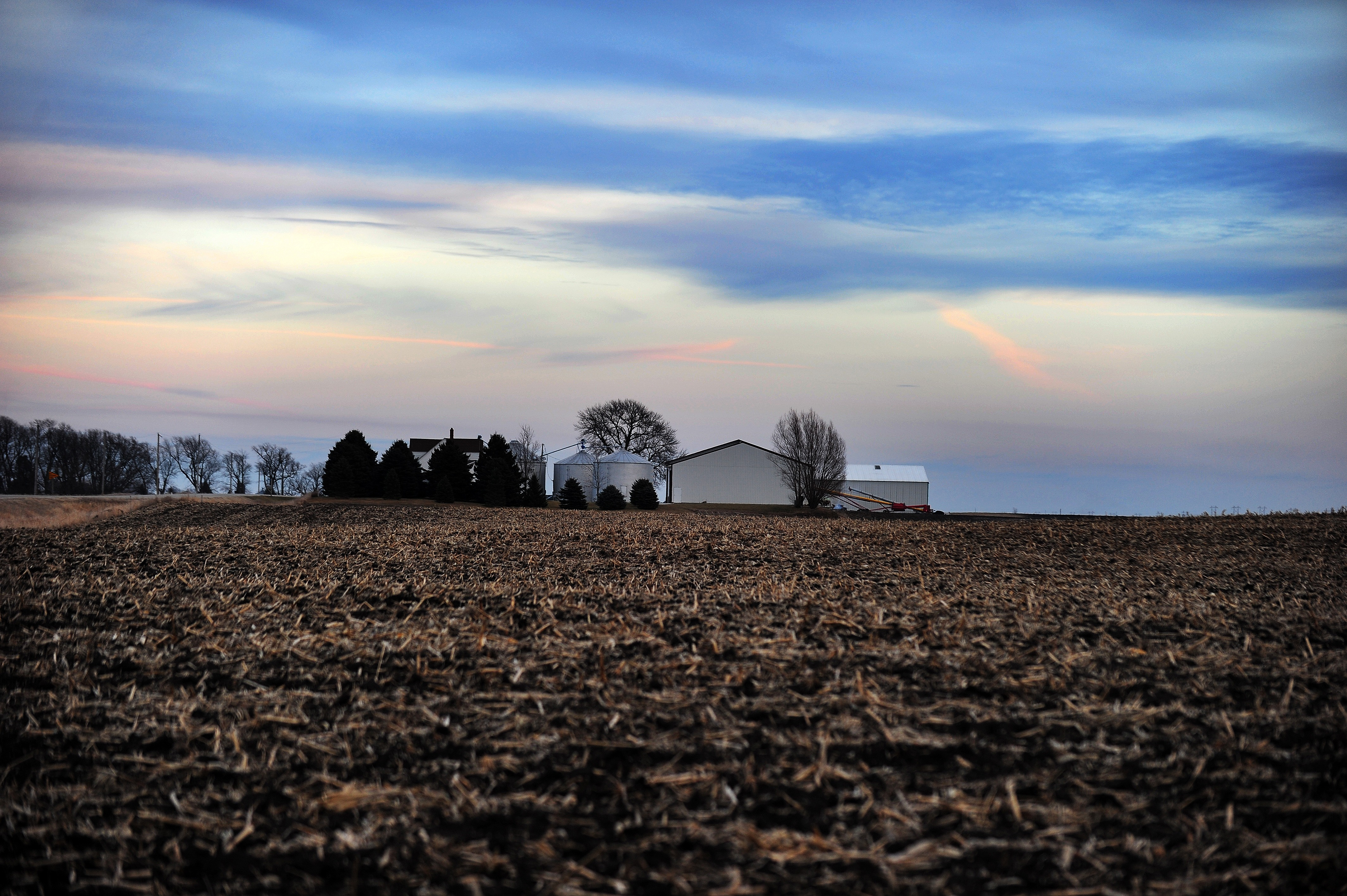 A farmhouse is picture at dusk in Ames,