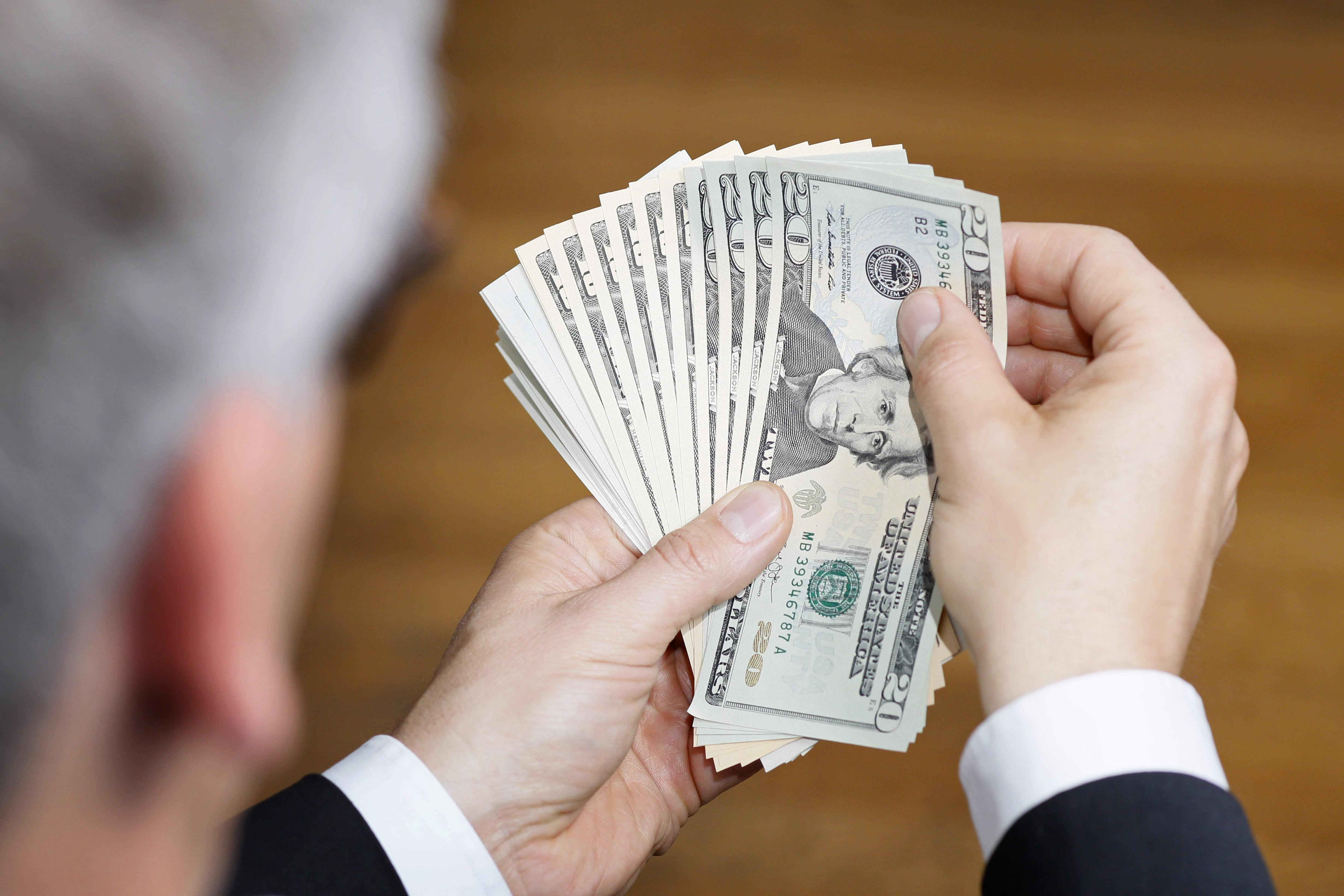 Businessman Holding US Dollars