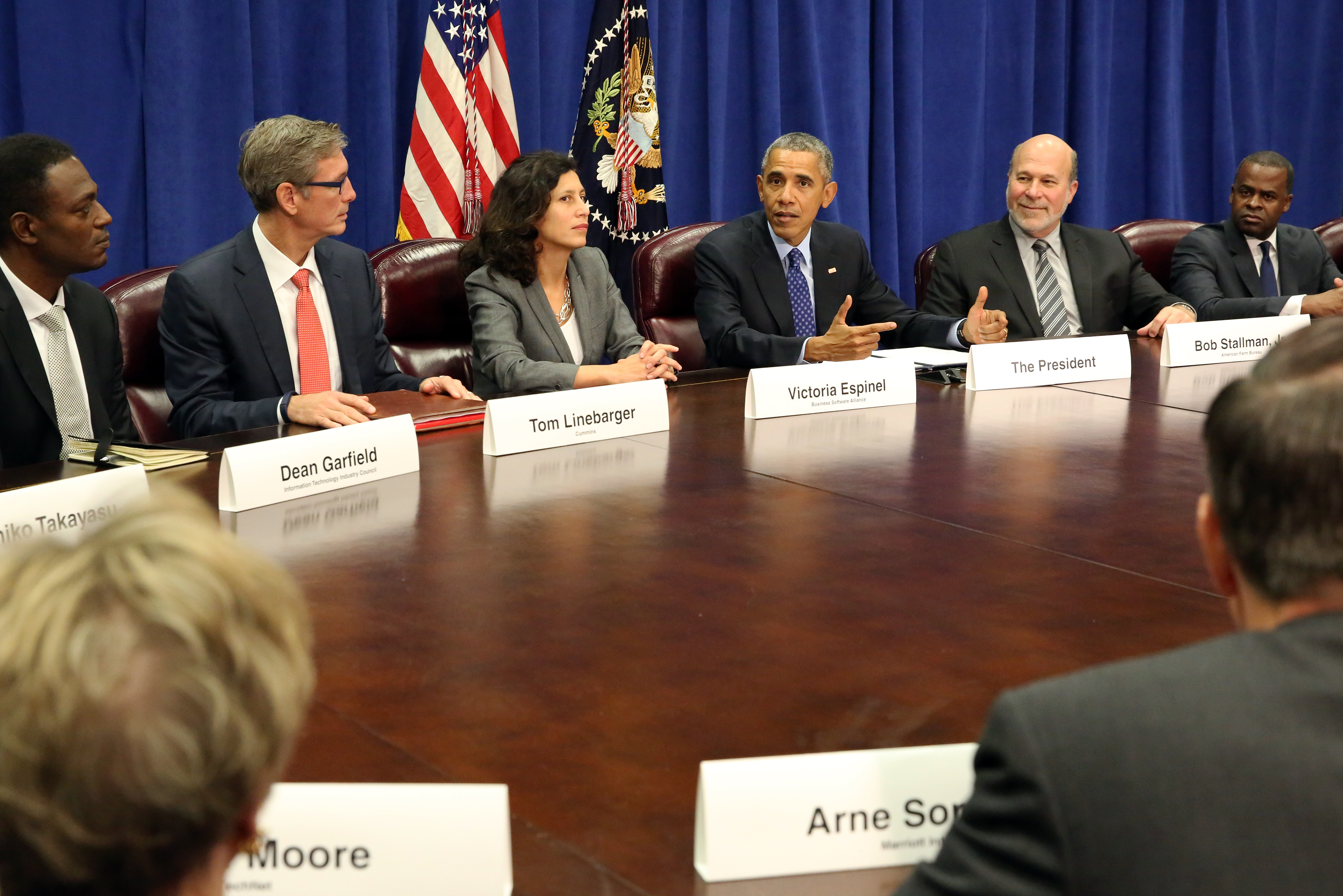 President Barack Obama meets with agriculture and business leaders on the benefits of the Trans-Pacific Partnership for American business and workers, at the Department of Agriculture in Washington, Tuesday, Oct. 6, 2015. Flanking the president are Victoria Espinel, CEO, The Software Alliance (left); and Bob Stallman, Jr., President, American Farm Bureau.