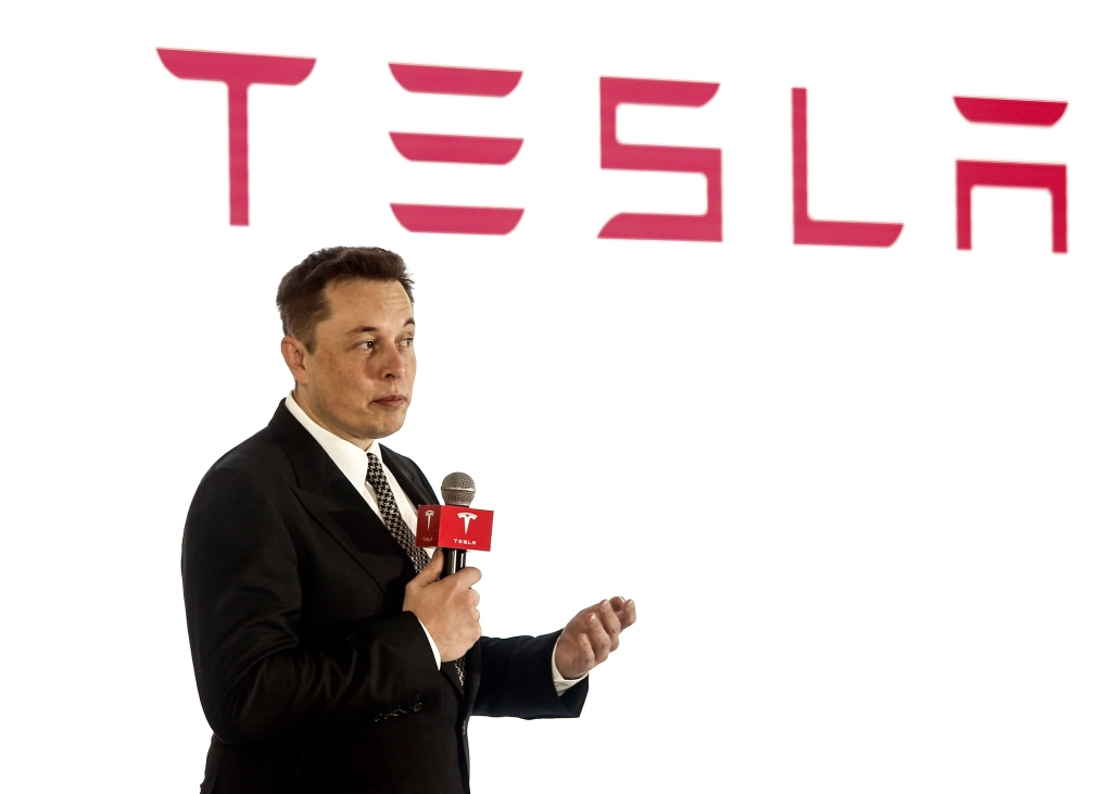 BEIJING, CHINA - OCTOBER 23: (CHINA OUT) Elon Musk, Chairman, CEO and Product Architect of Tesla Motors, addresses a press conference to declare that the Tesla Motors releases v7.0 System in China on a limited basis for its Model S, which will enable self-driving features such as Autosteer for a select group of beta testers on October 23, 2015 in Beijing, China. The v7.0 system includes Autosteer, a new Autopilot feature. While it's not absolutely self-driving and the driver still need to hold the steering wheel and be mindful of road conditions and surrounding traffic when using Autosteer. When set to the new Autosteer mode, graphics on the driver's display will show the path the Model S is following, post the current speed limit and indicate if a car is in front of the Tesla. (Photo by ChinaFotoPress)***_***