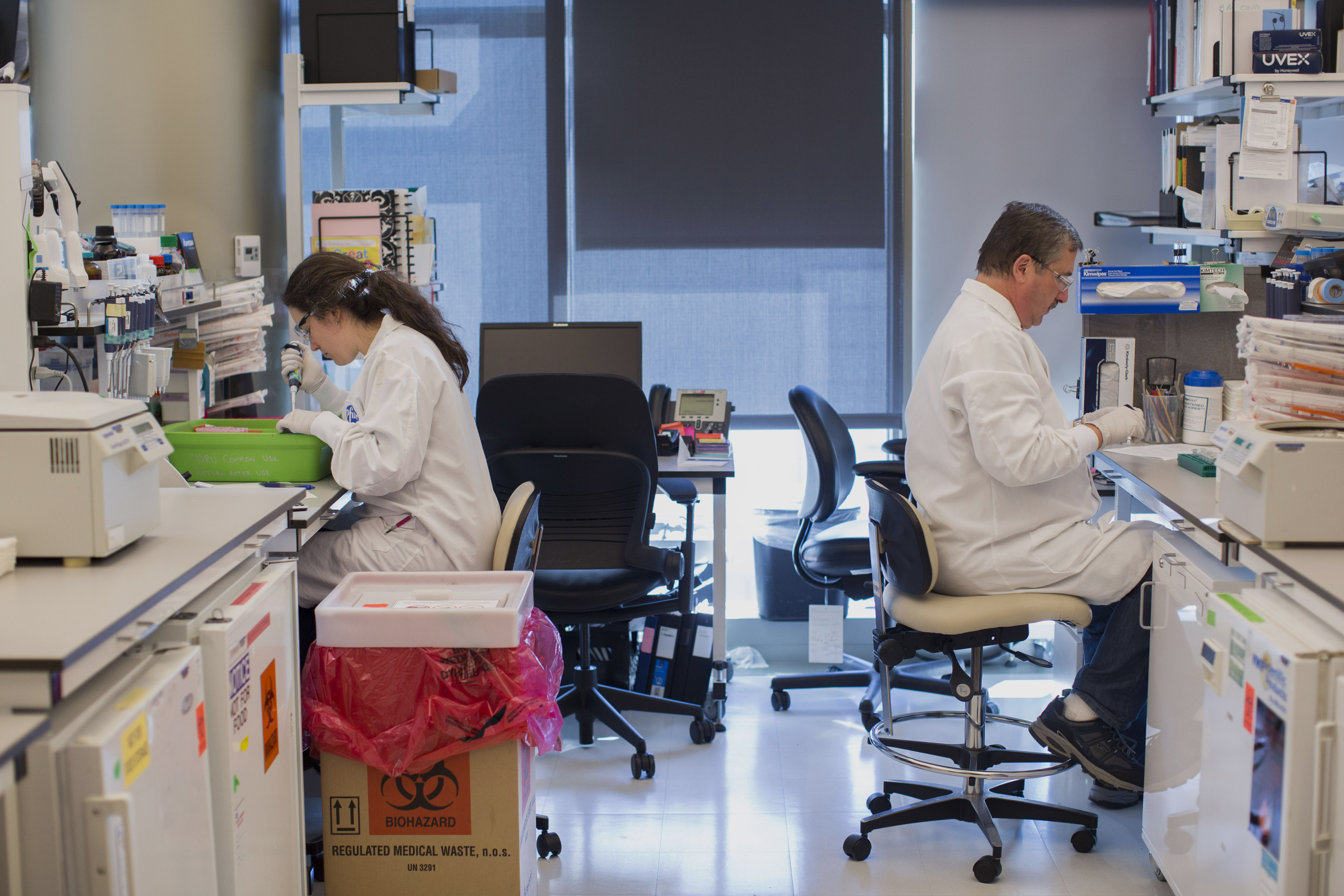 Pfizer employees inside of a laboratory at Pfizer's research and development facility in Cambridge, Massachusetts, U.S., on Monday, Oct. 26, 2015. Photographer: Scott Eisen/Bloomberg *** Local Caption ***