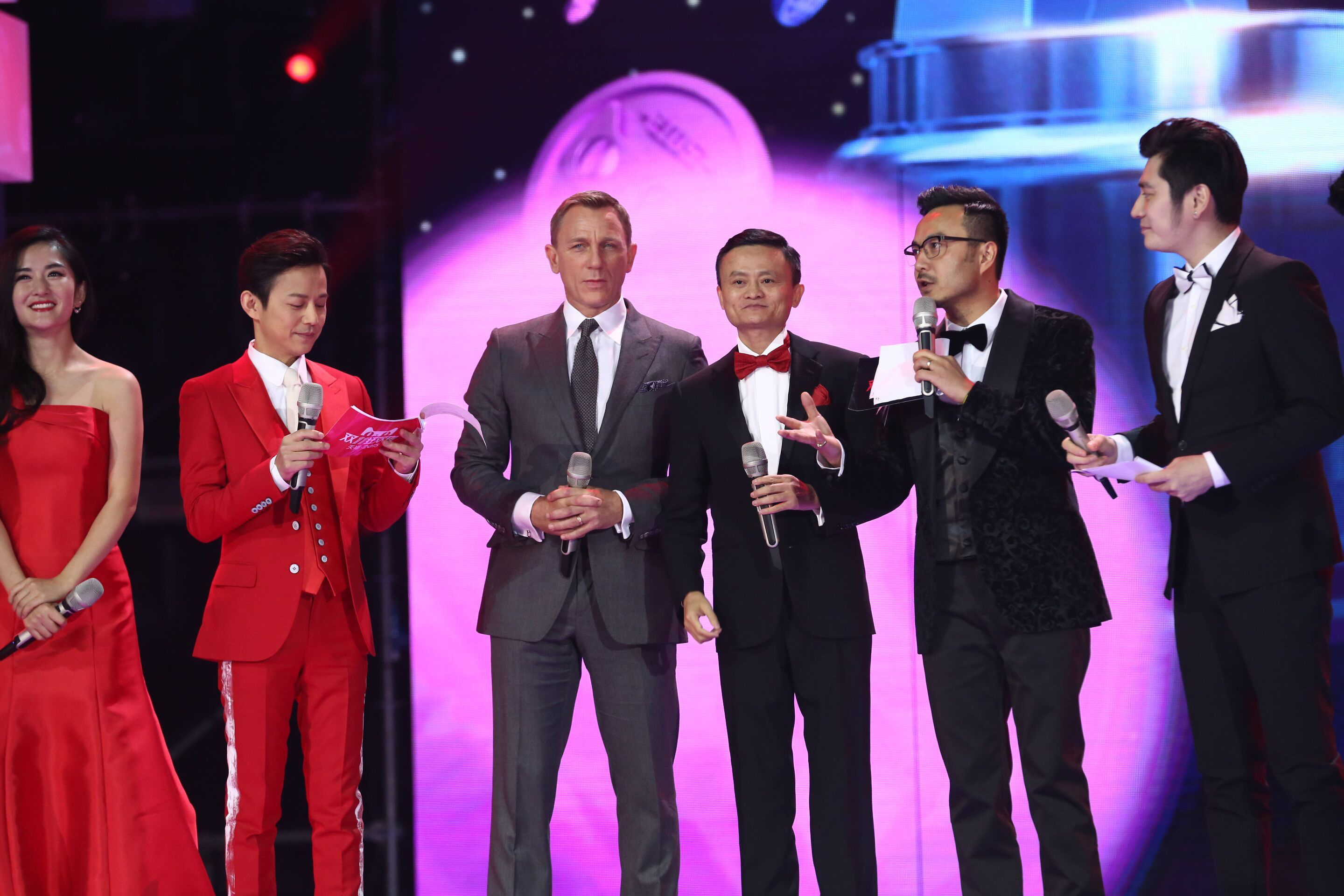 """BEIJING, CHINA - NOVEMBER 10: (CHINA OUT) British actor Daniel Craig (L3) and Alibaba Chairman Jack Ma (R3) attend the ceremony of 2015 Tmall 11.11 Global Shopping Festival at the Water Cube on November 10, 2015 in Beijing, China. Alibaba Group and Hunan television held a ceremony at the Water Cube (aka National Aquatics Center) for the 2015 Tmall 11.11 Global Shopping Festival which attracted consumers to shop on Tmall.com with discounts on November 11 which was also called the """"Singles Day"""". (Photo by ChinaFotoPress)***_***"""