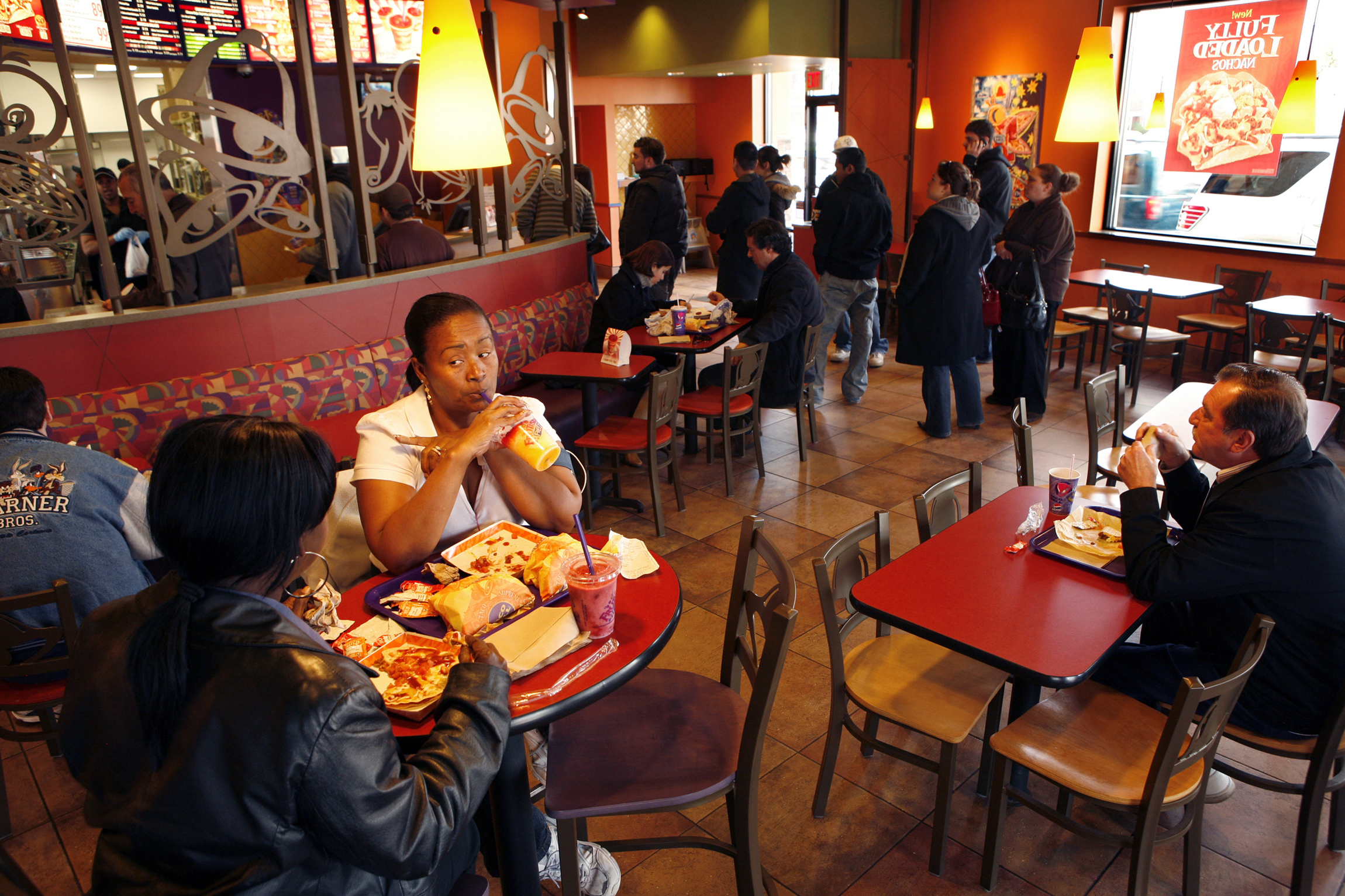 Customers have lunch at a newly remodeled Taco Bell in Flushing, New York, including Claydine Andre