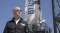 Jeff Bezos poses beside one of Blue Origin's rockets.