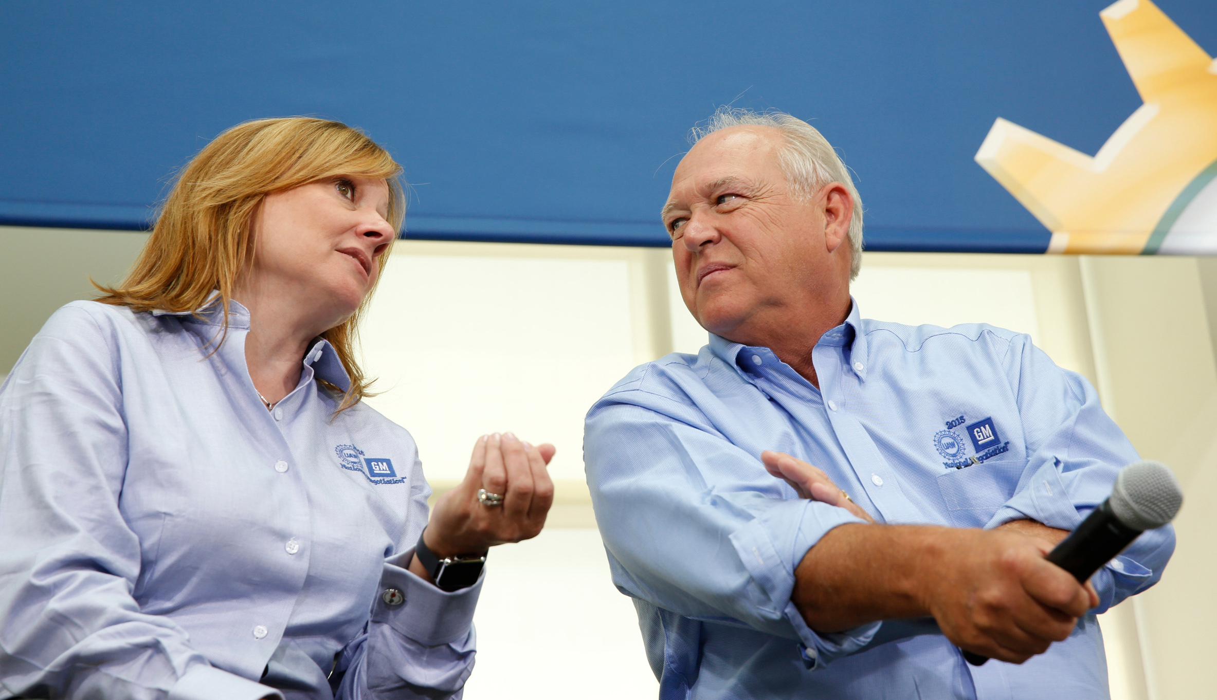 Mary Barra, GM Chief Executive Officer with Dennis Williams, President - International Union, UAW at the UAW-GM 2015 Negotiations Kick-off at the UAW-GM Center for Human Resources in Detroit, Michigan, U.S., on Monday, July 13, 2015.  Photographer: Jeff Kowalsky/Bloomberg *** Local Caption ***