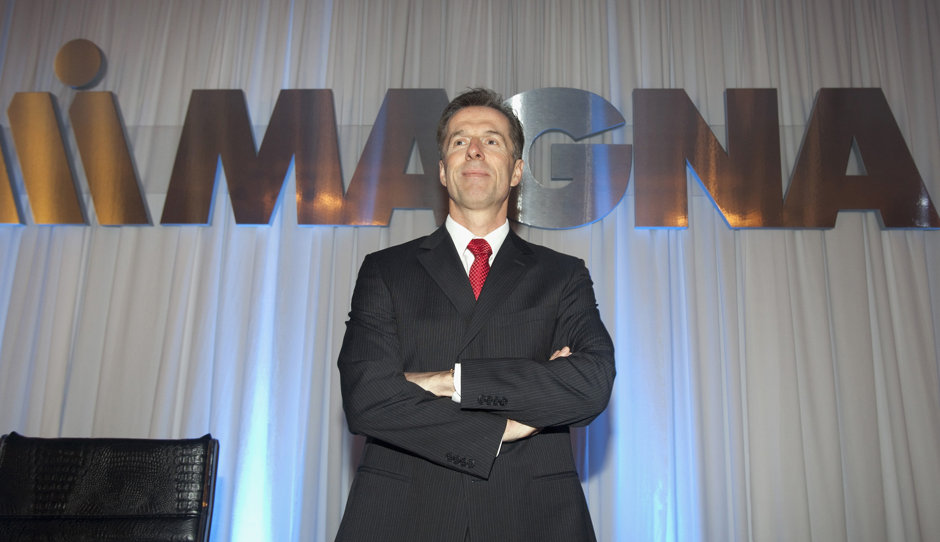 CEO for Magna International Inc. Walker waits for the annual general meeting to start in Toronto