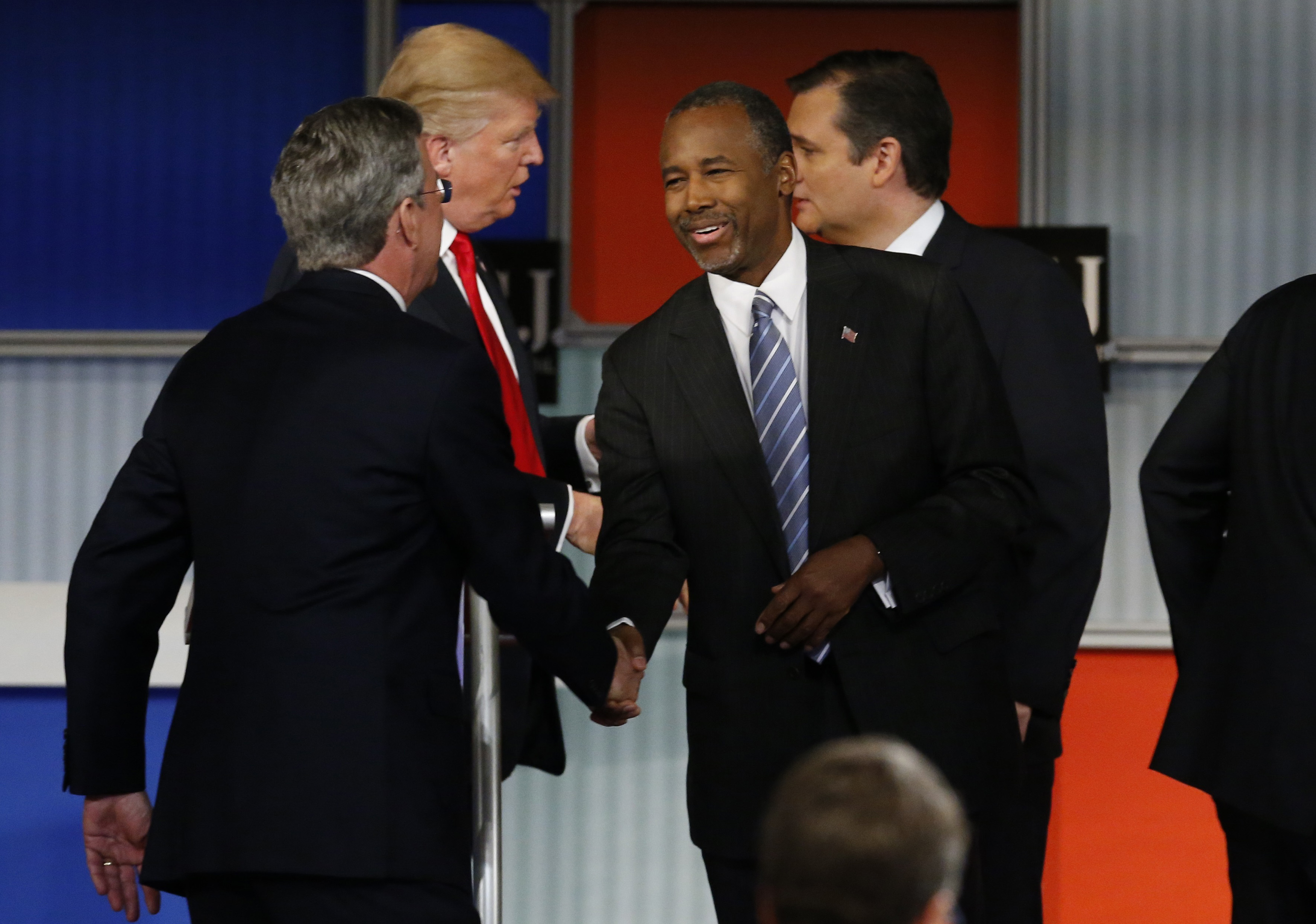 Republican U.S. presidential candidates Bush, Trump, Carson and Cruz shake hands at the conclusion of the debate held by Fox Business Network for the top 2016 U.S. Republican presidential candidates in Milwaukee