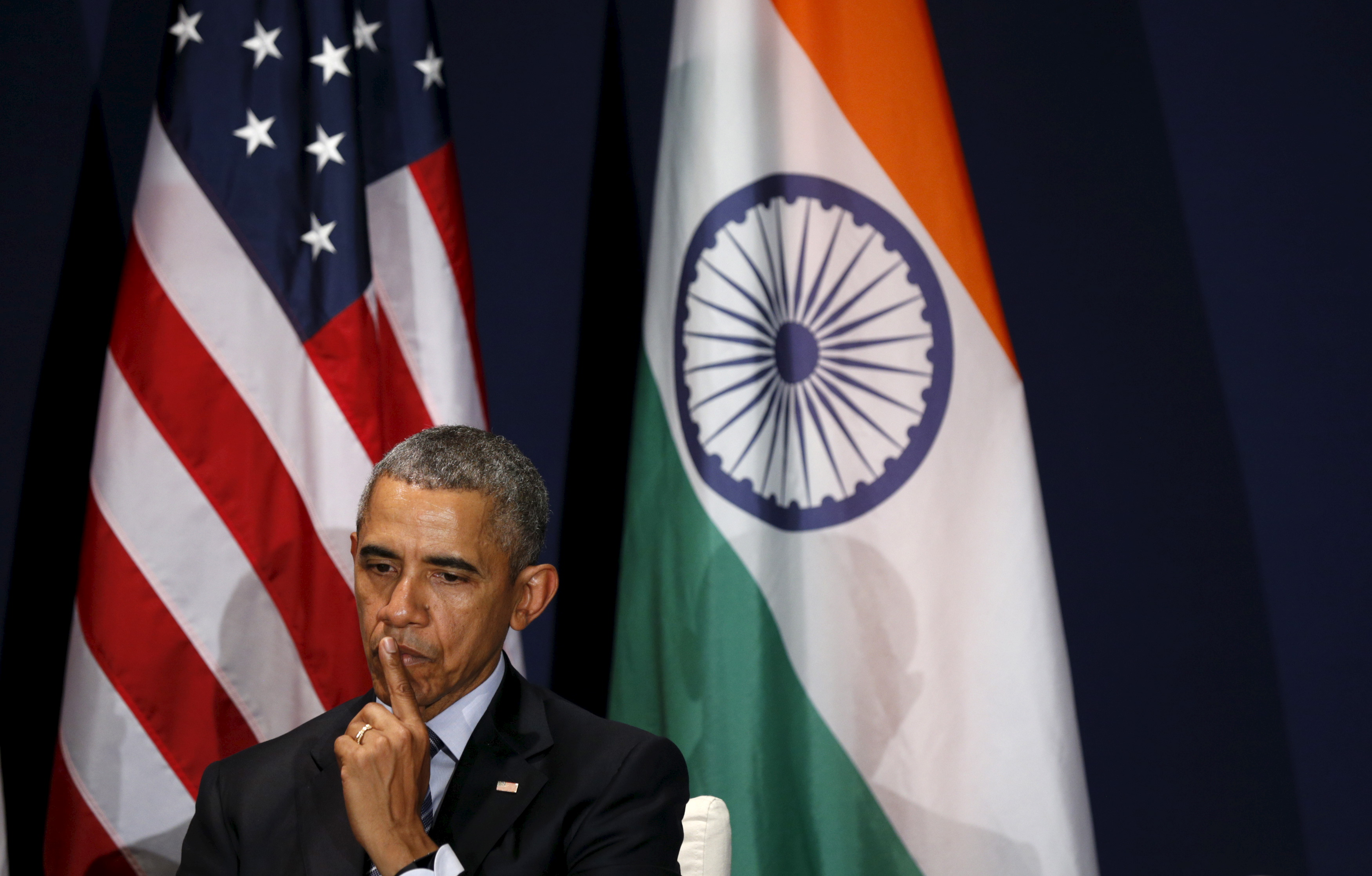U.S. President Obama listens to Indian Prime Minister Modi speak during their meeting at the climate change summit in Paris